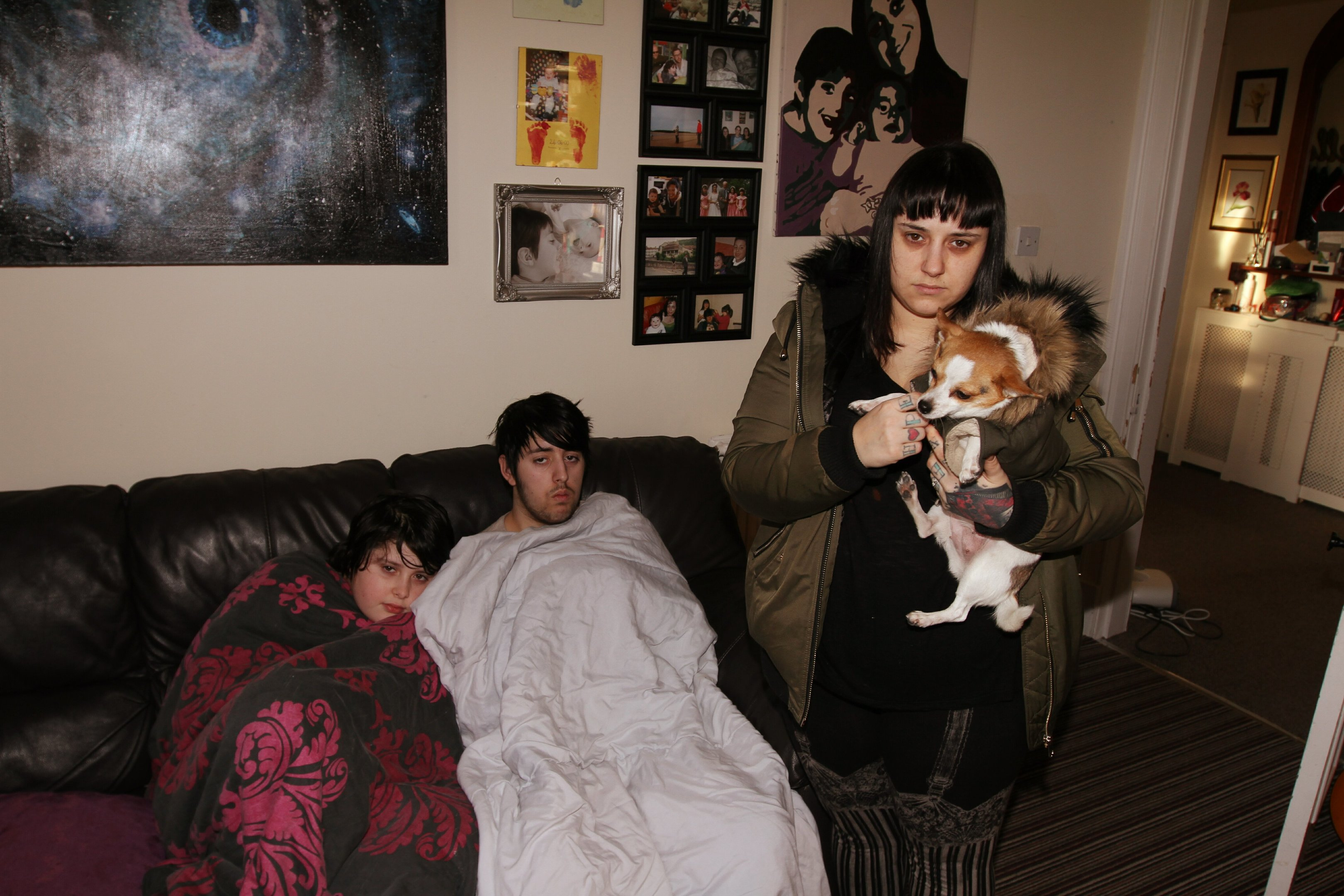 Deborah (right), with kids Logan and Brandon, has struggled with keeping her house warm.