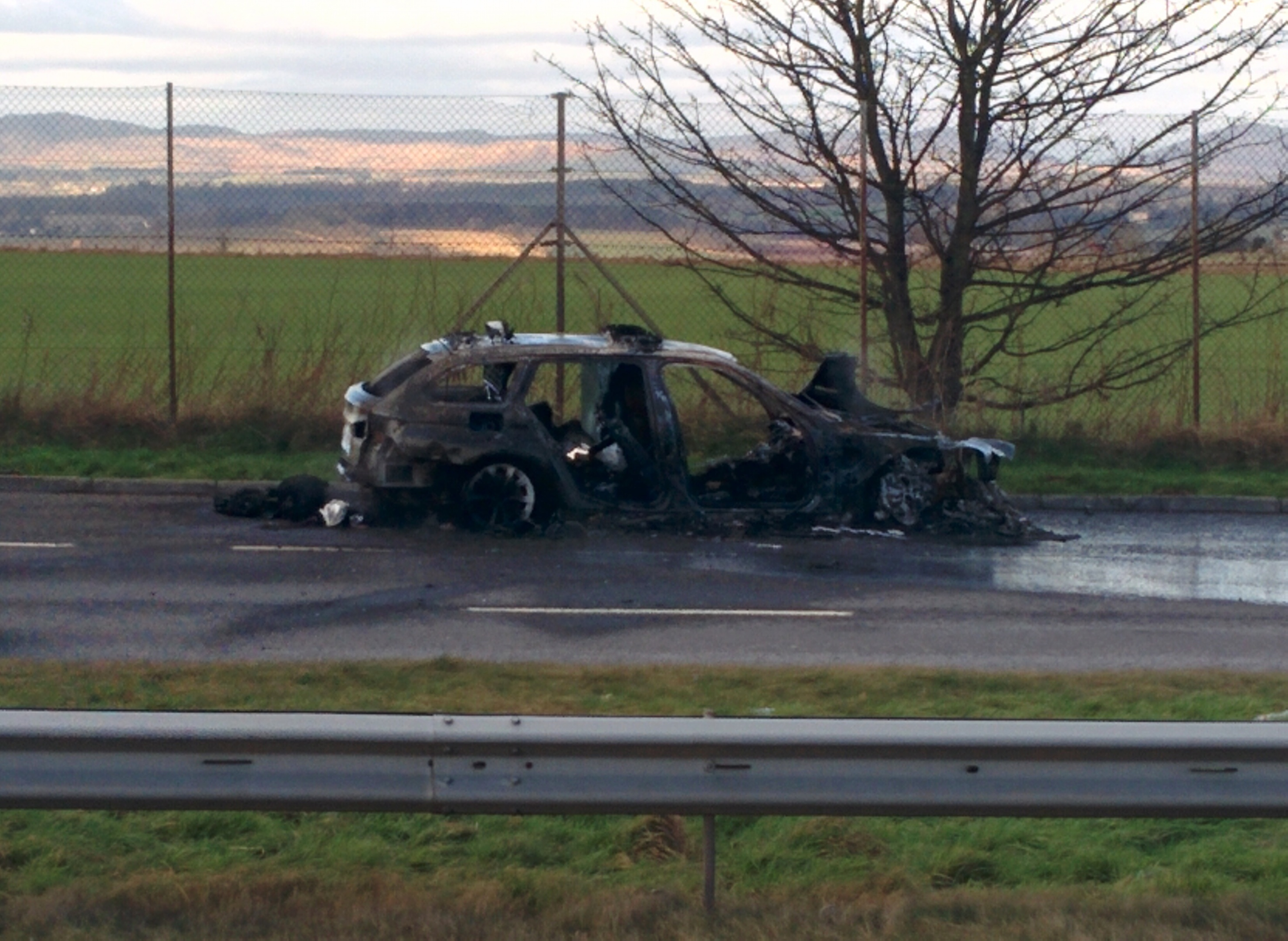 The burnt out car on the A9.