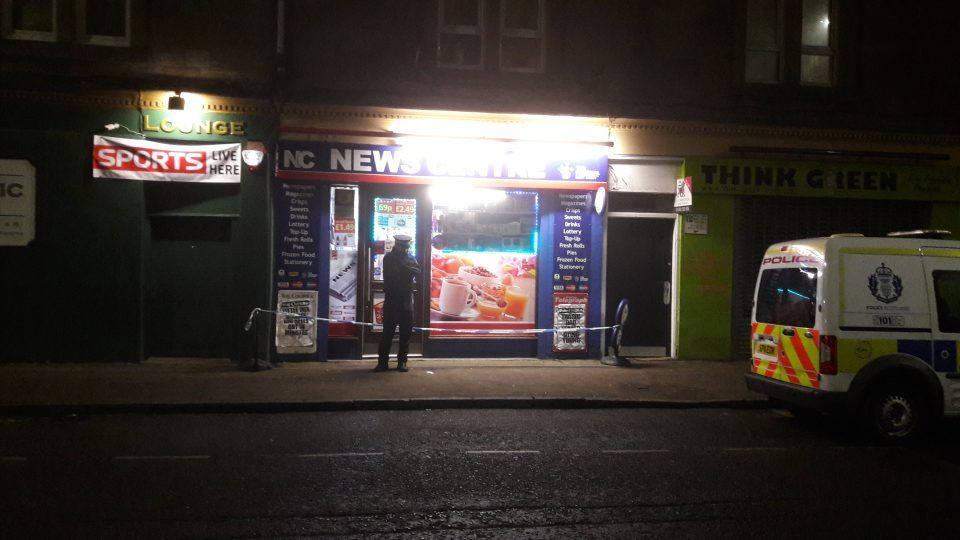 Police outside the shop on Saturday