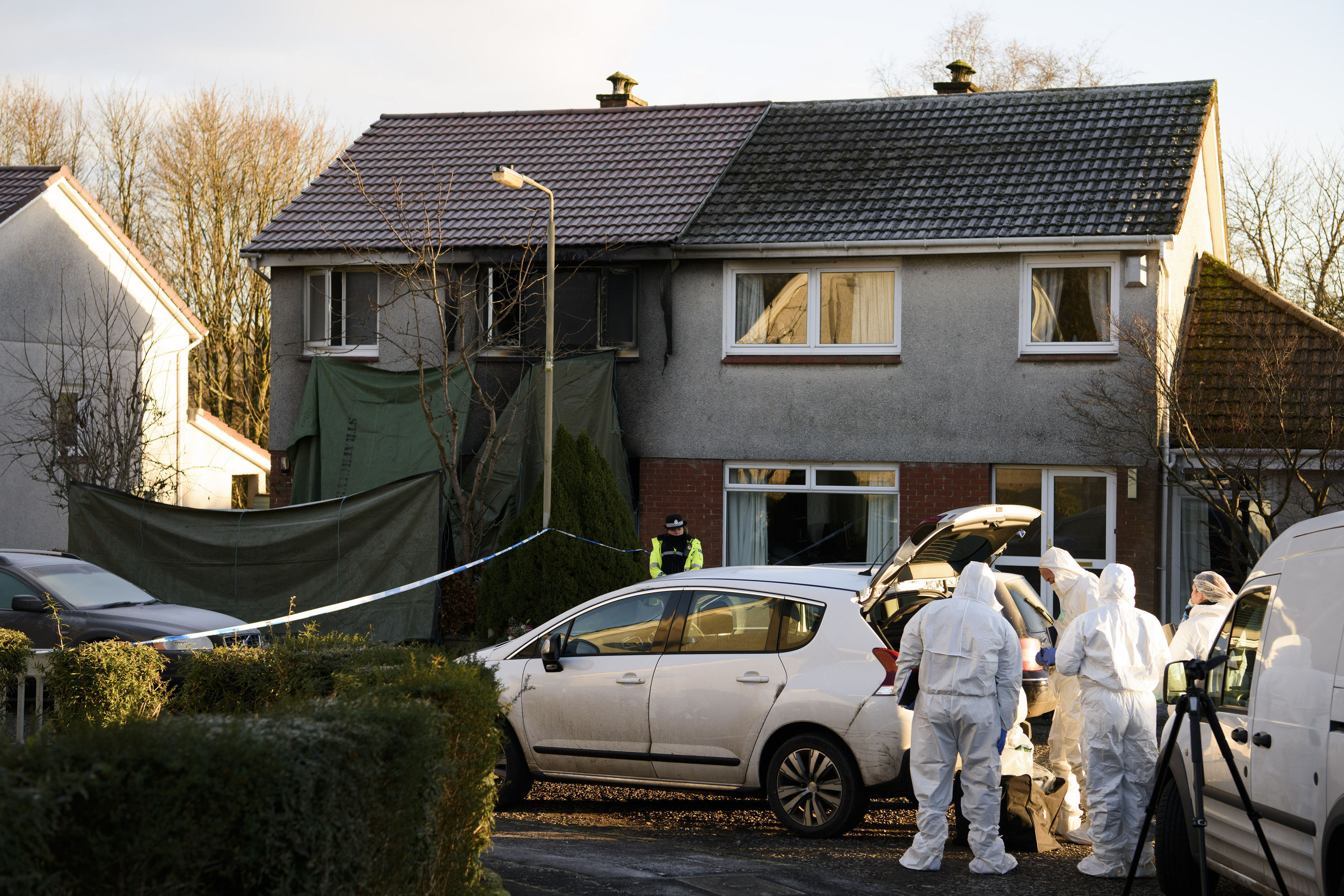 Forensics at the scene of the fatal fire in Milngavie