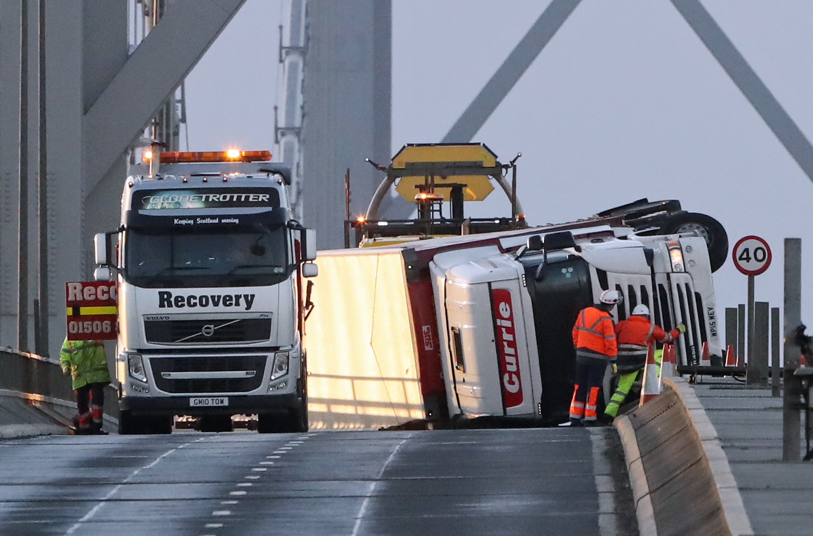 The overturned lorry in January