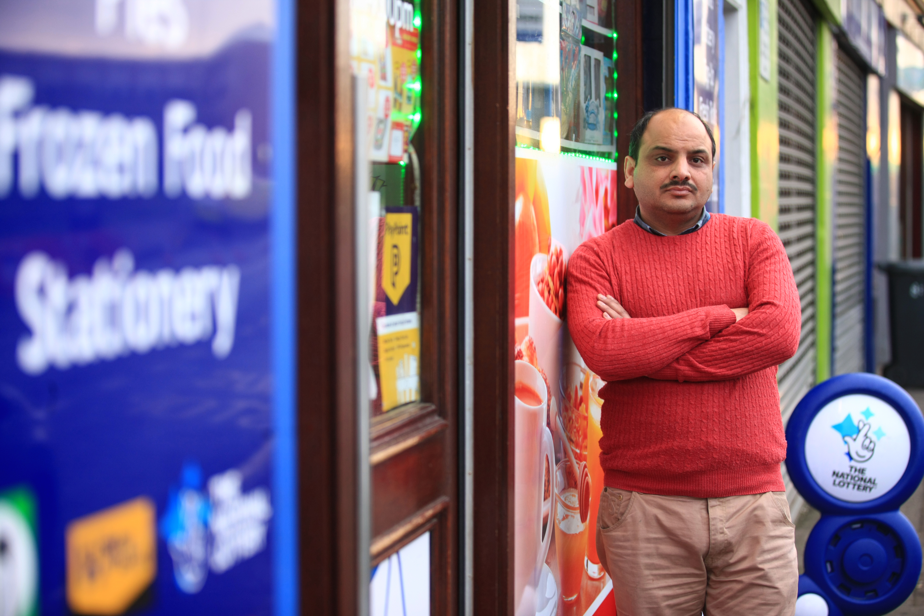 Hassan Majid outside his shop in the Hilltown