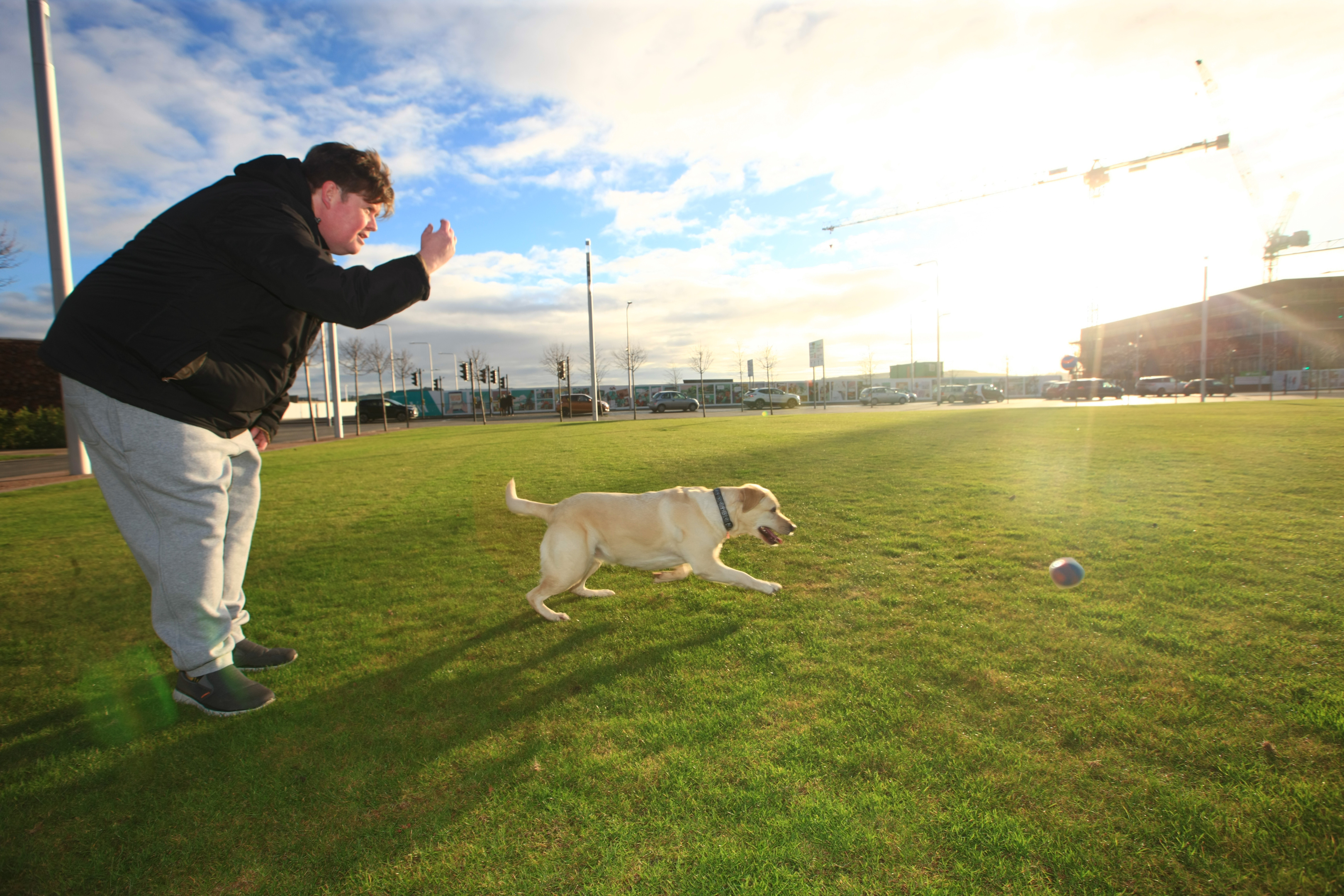 Stephen McGuinness, 47, enjoys the dry and sunny weather with his Labrador Poppy.