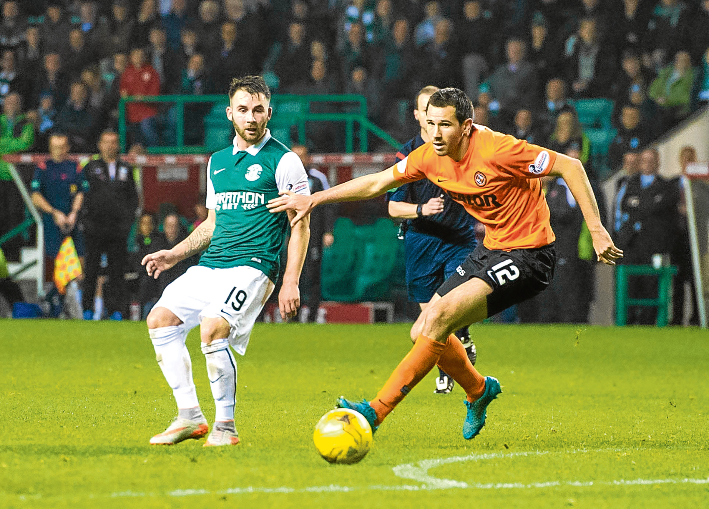 Former Dundee United defender Ryan McGowan has returned to Scotland after falling foul of the number of import players rules in China.