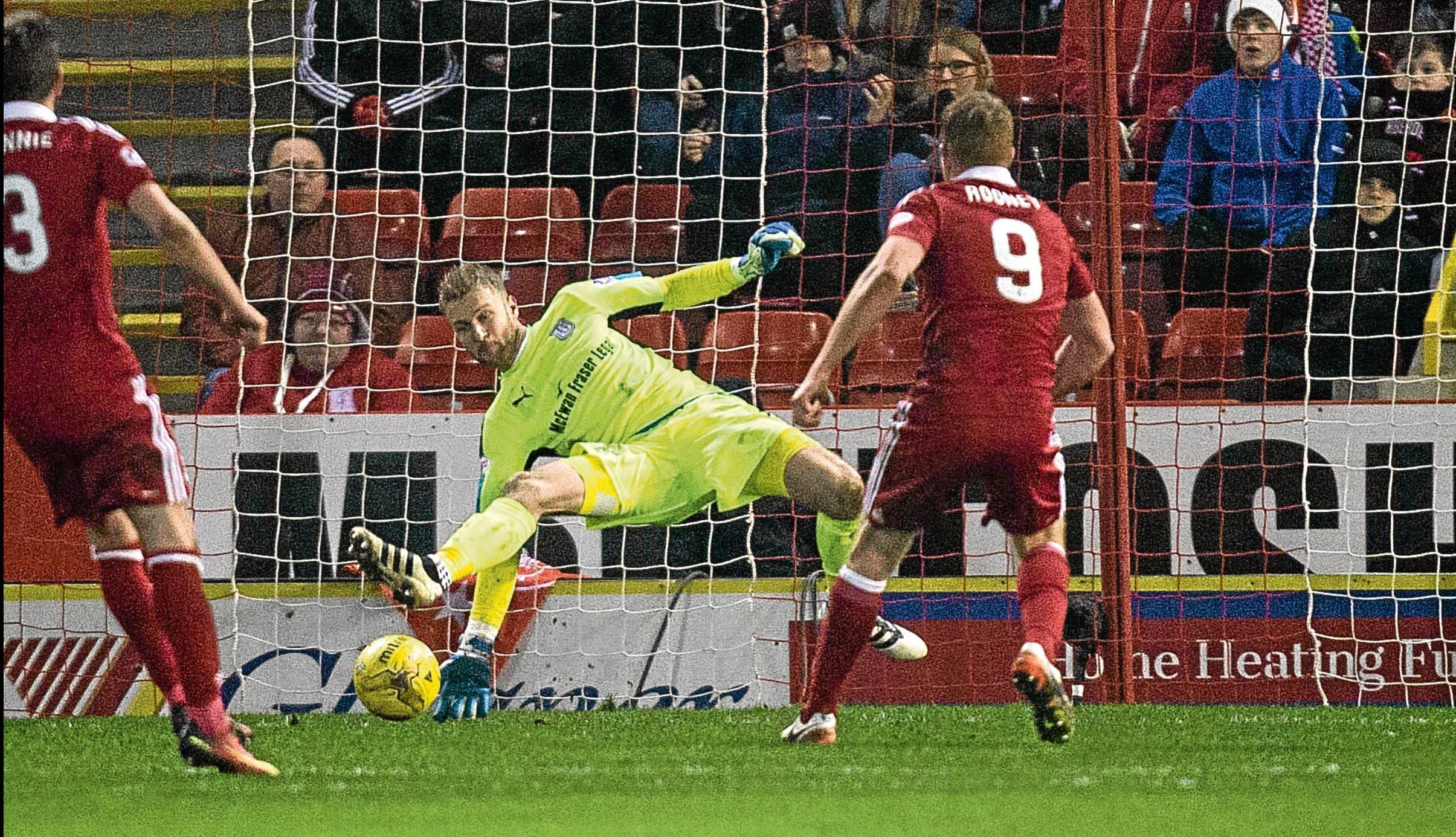 Dundee keeper Scott Bain  was put through his paces against Aberdeen