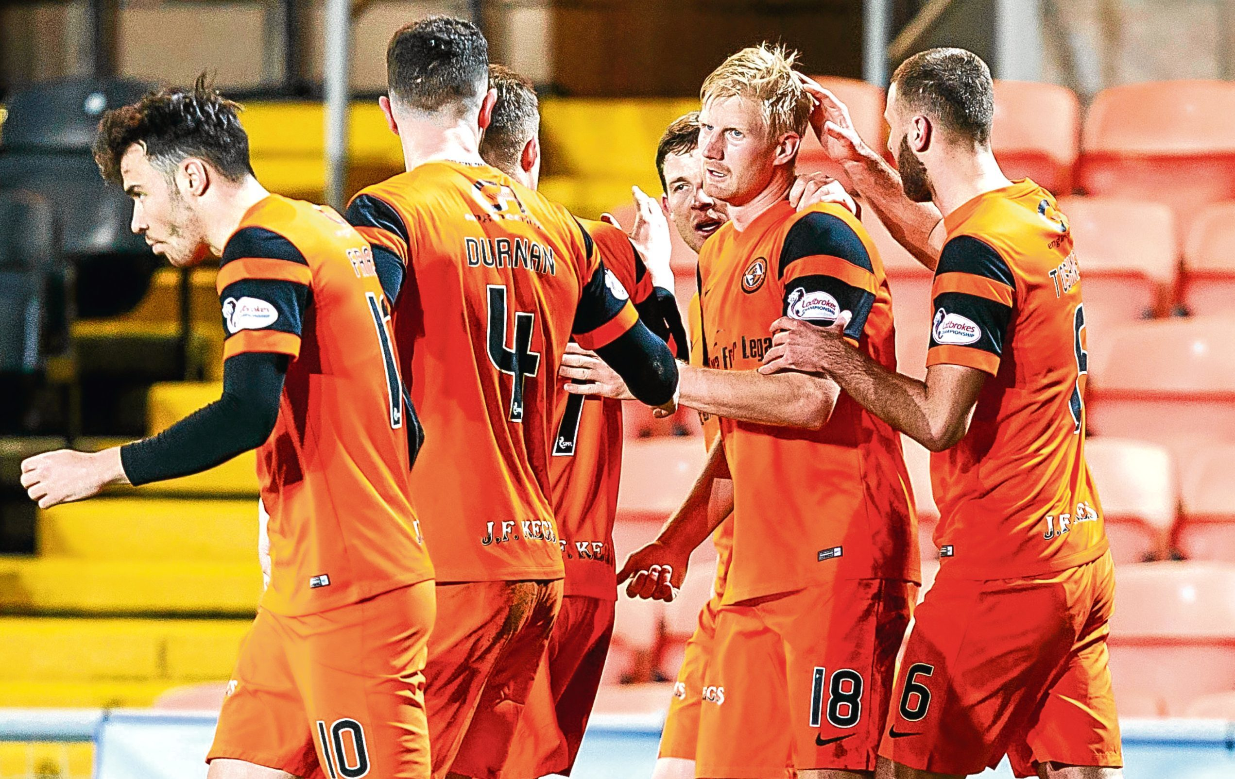 Mikkelsen (18) celebrates with teammates after scoring his side's first goal against Raith
