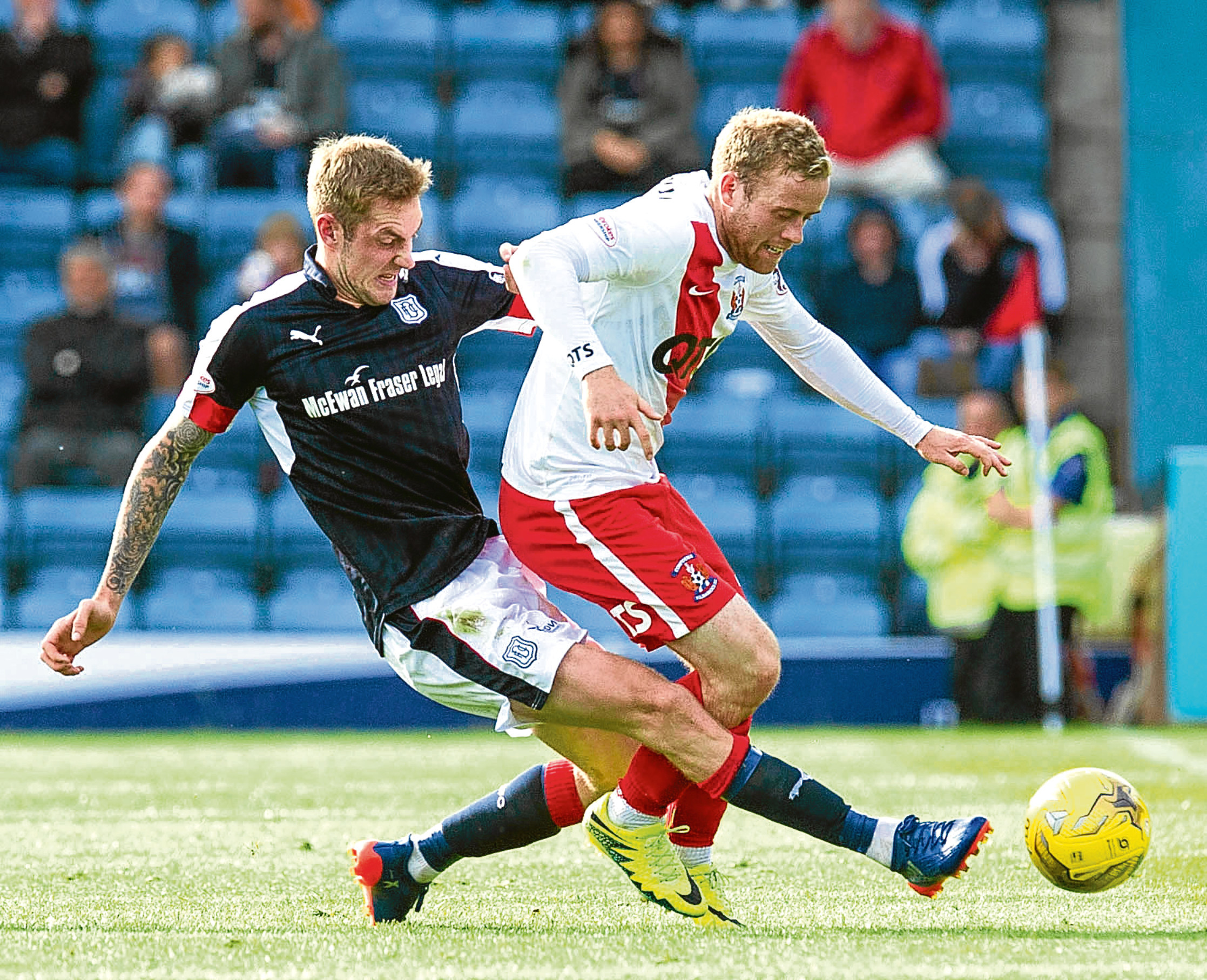 Dundee's Kevin Holt battles for the ball against Kilmarnock's Rory McKenzie.