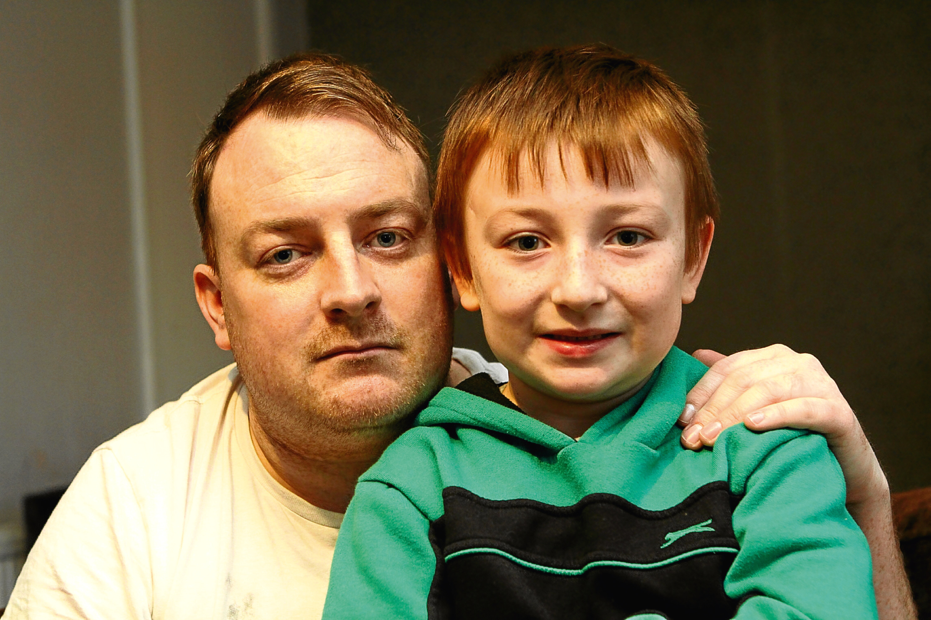 Kai Nicoll, 6, with his dad Alan at home in Dundee