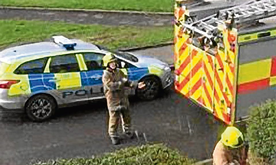 Firefighters were called in to help police gain entry to a flat.