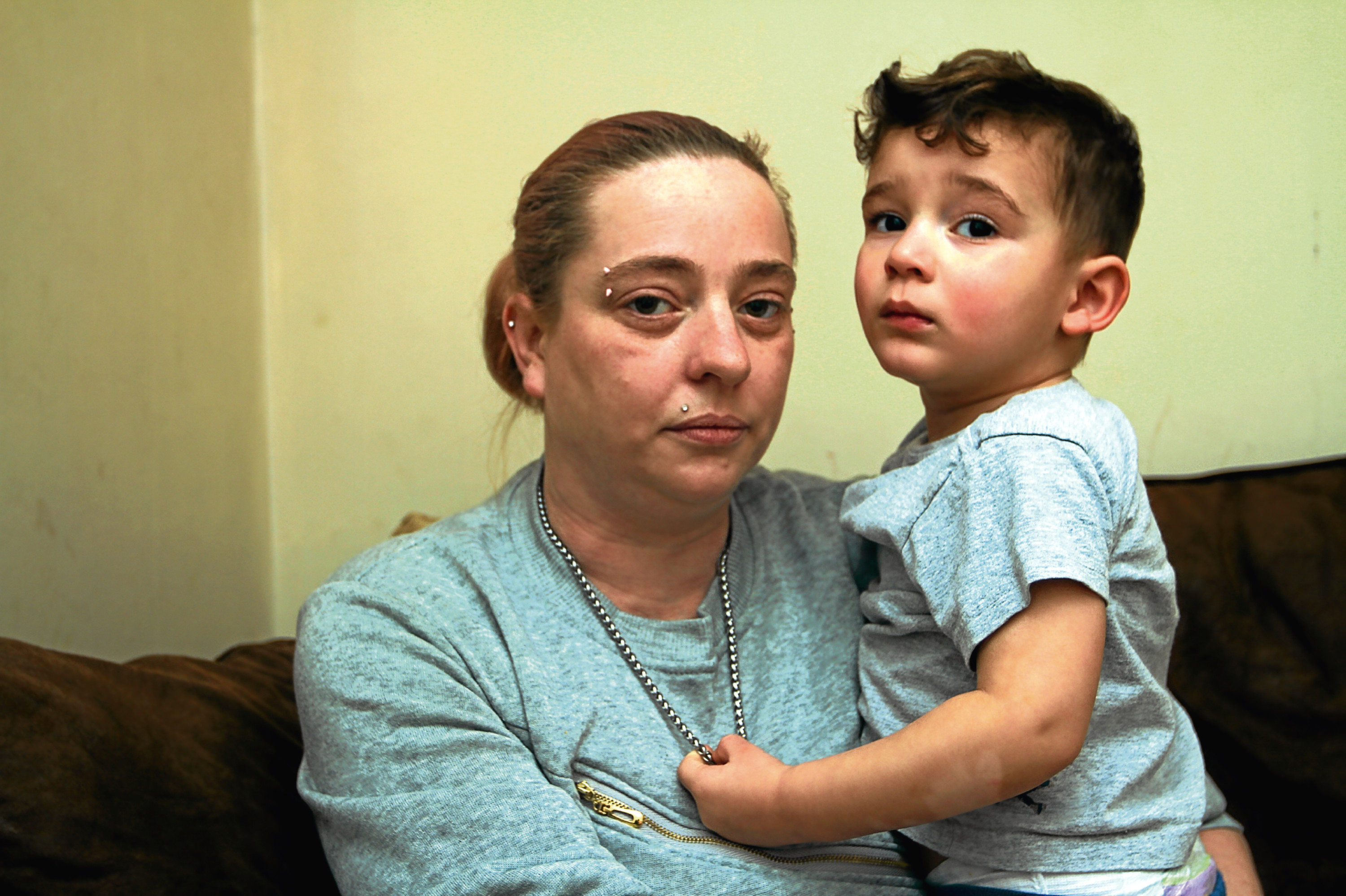 Diane Thomson, 32, pictured at home with son Riley — whose father, Mark Boucher, is behind bars.