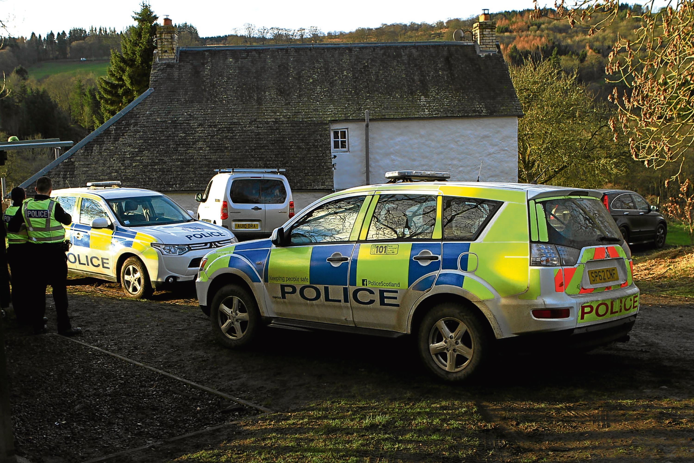 Police near the scene on Monday.