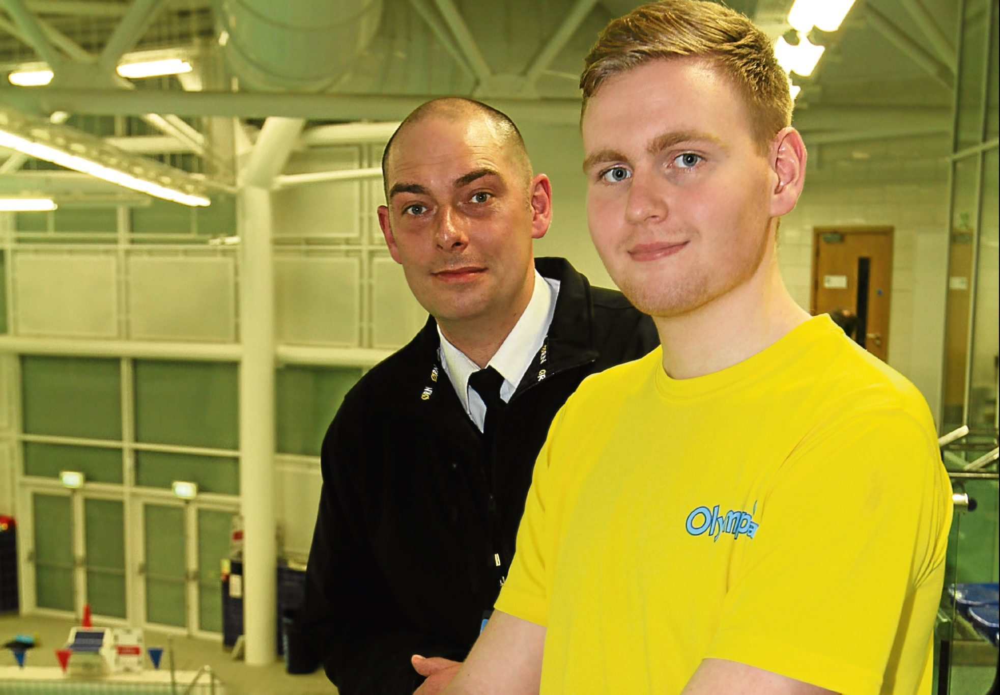 Shaun Simpson and lifeguard Duncan Johnston saved an unconscious teenager from drowning at the Olympia swimming pool in Dundee.