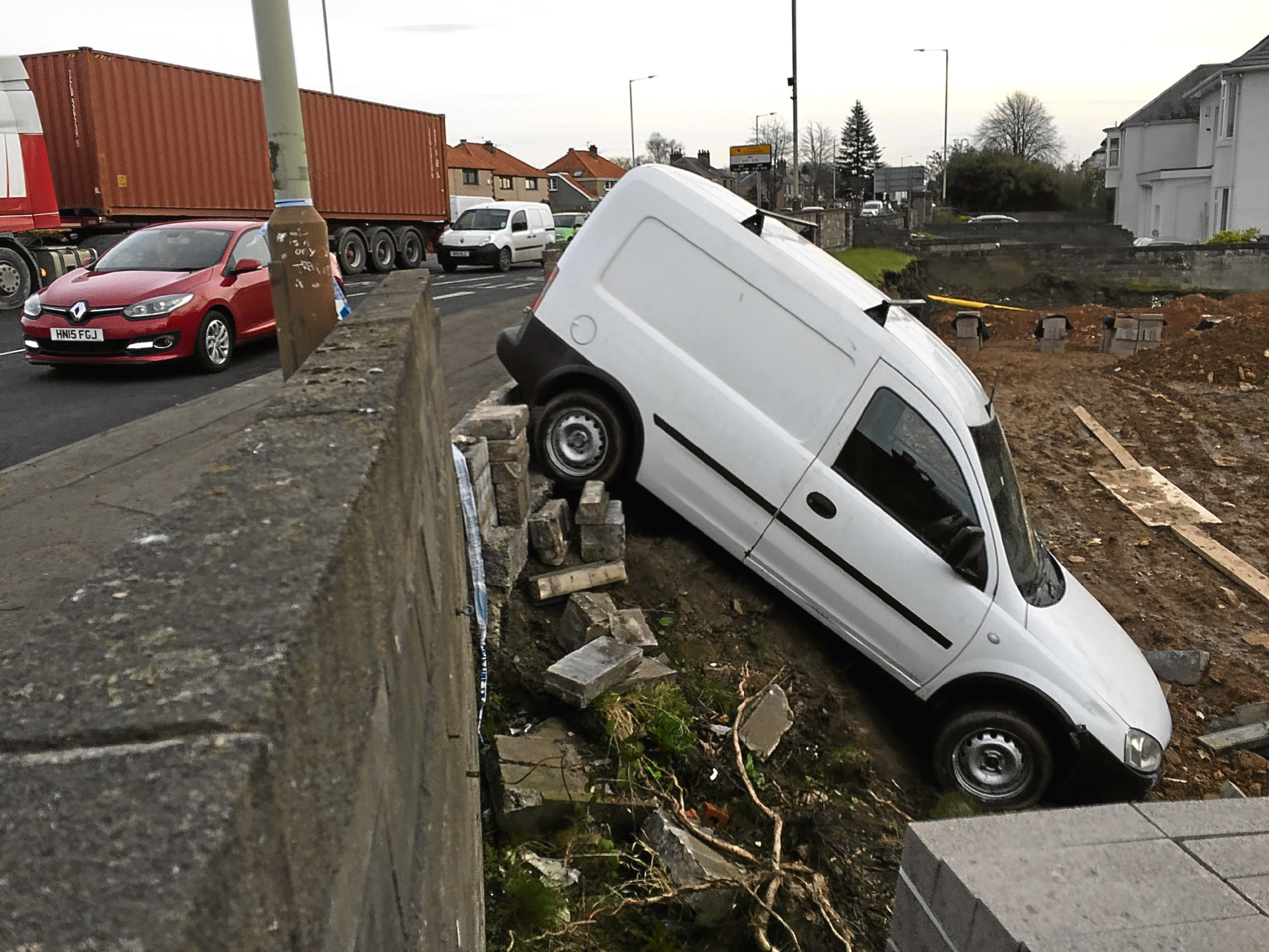 The white van pictured after having crashed through the wall near the Scott Fyffe Roundabout.