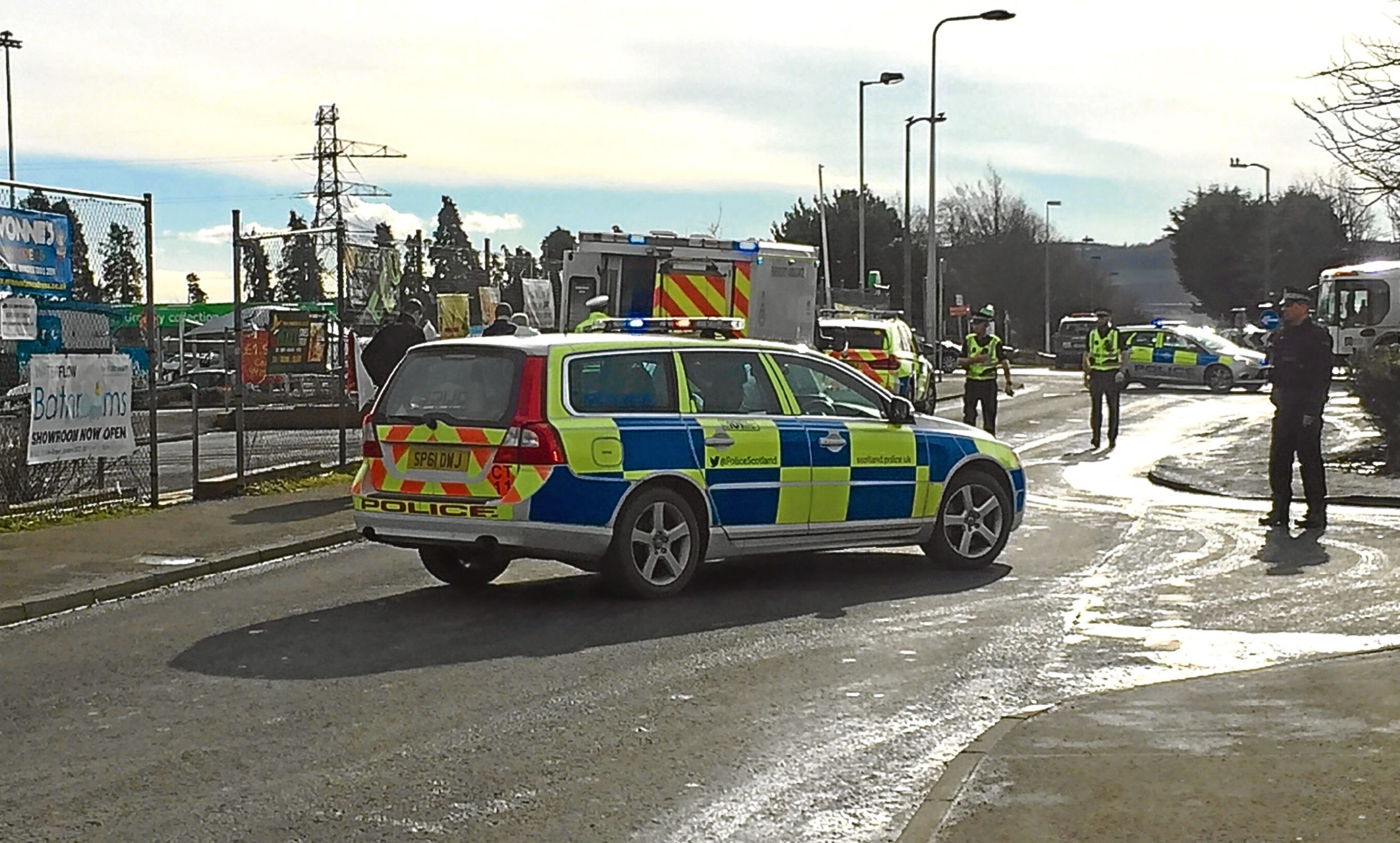 Police and an ambulance at the scene of the incident.