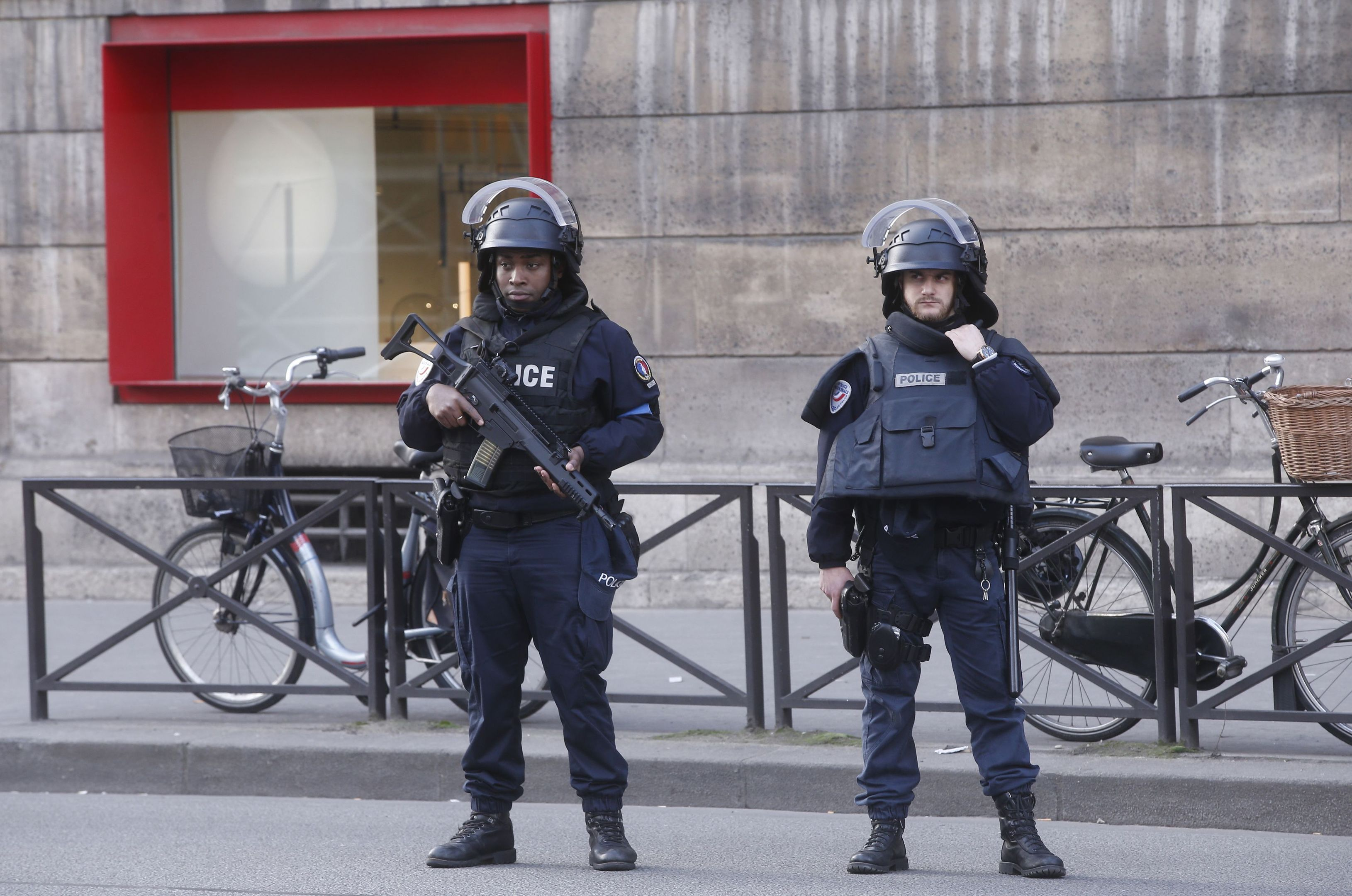 Armed police officers take position outside the Louvre museum in Paris.