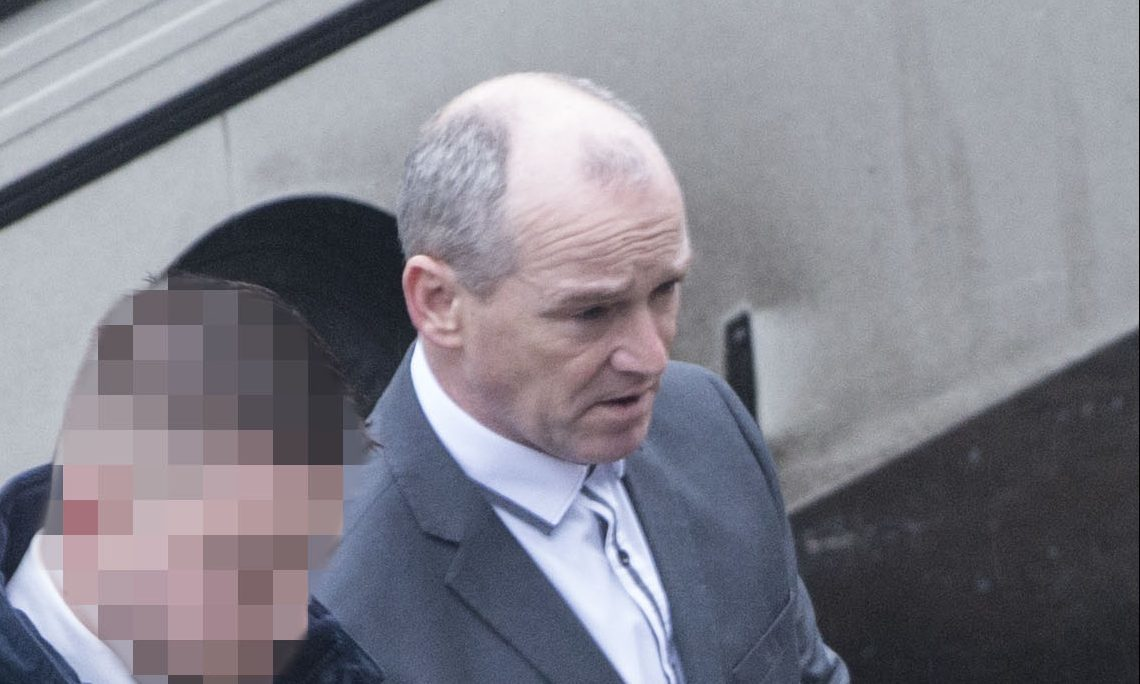 John Newlands is led away at Dundee Sheriff Court.