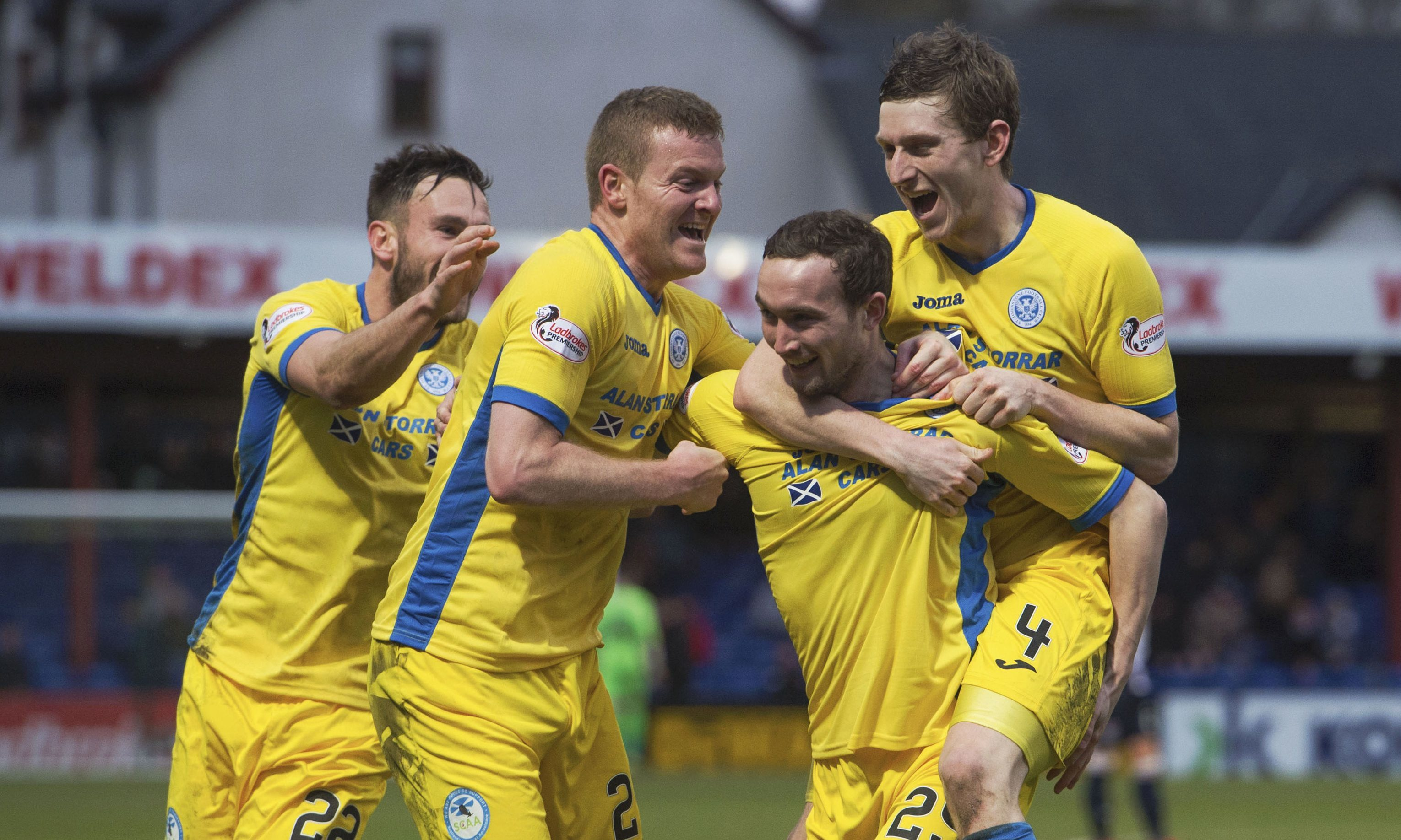 St Johnstone's Chris Kane is mobbed by teammates after clinching his side's late winner.