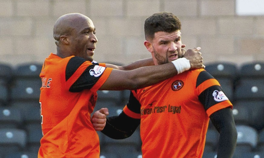 Dundee United's William Edjenguele congratulates Mark Durnan on his goal - although he didn't know too much about it.