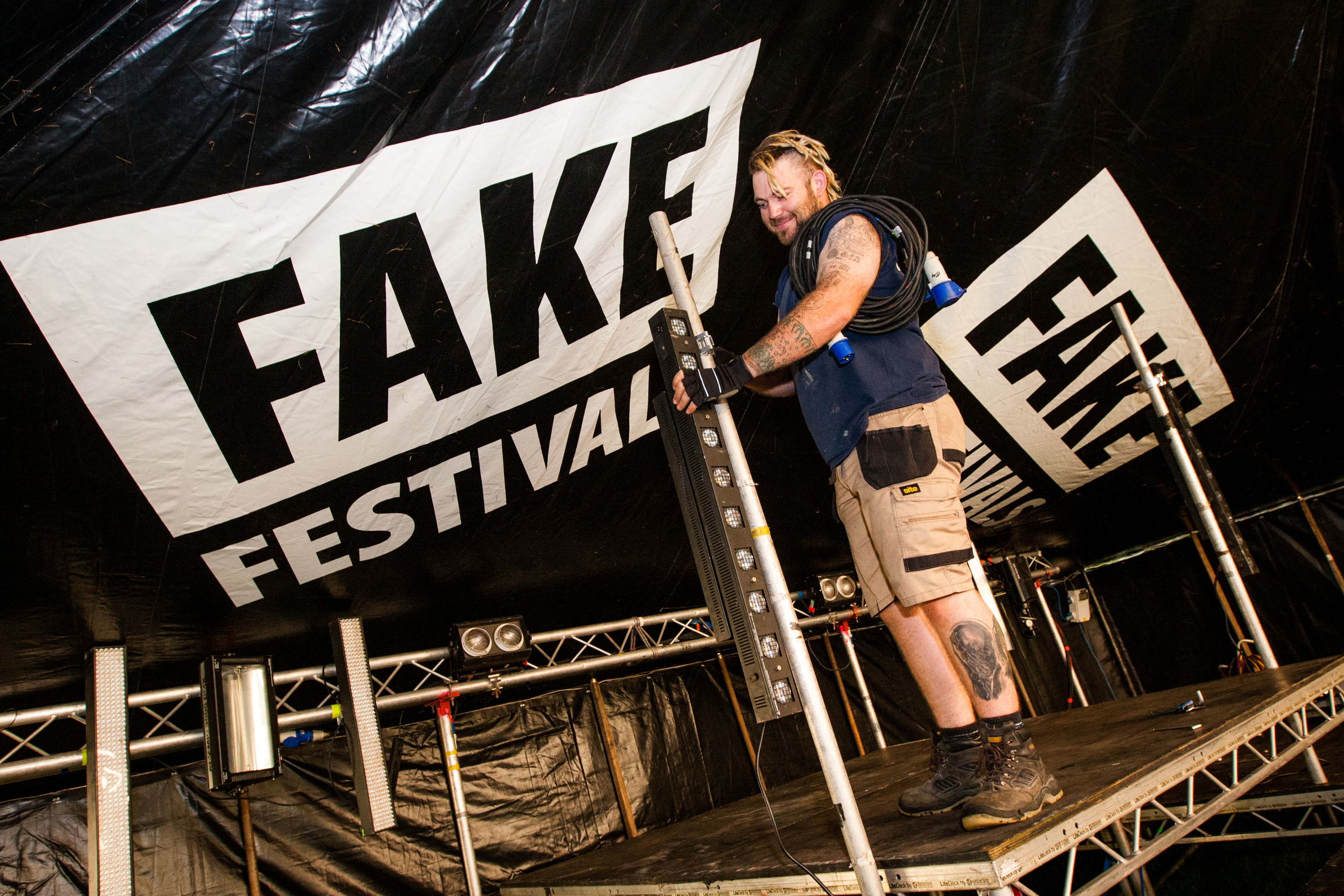 Technician Nigel Covill sets the stage at the Perth Fake Festival last year.