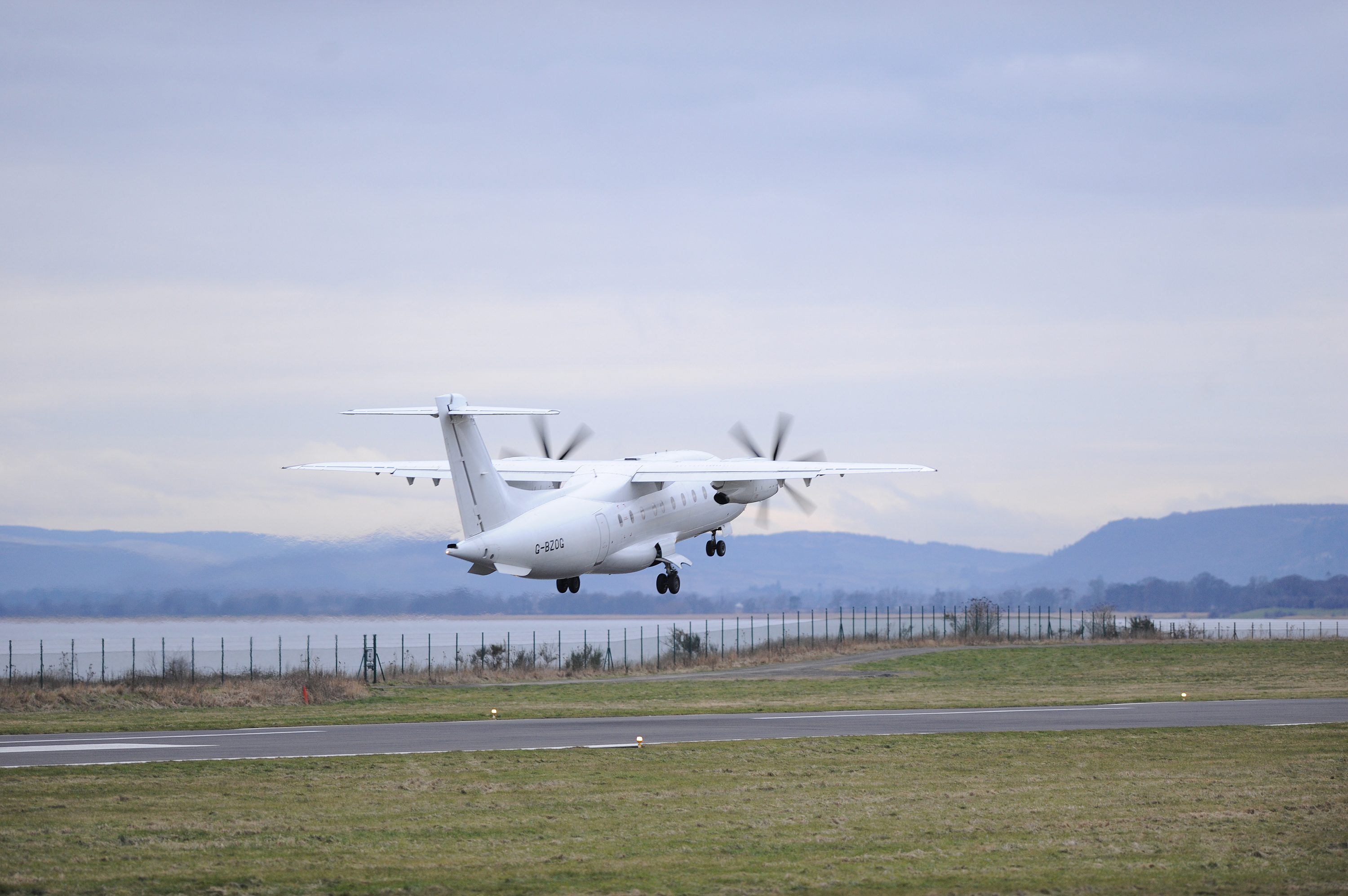 A flight leaves Dundee Airport for London. The route has been secured for two more years.