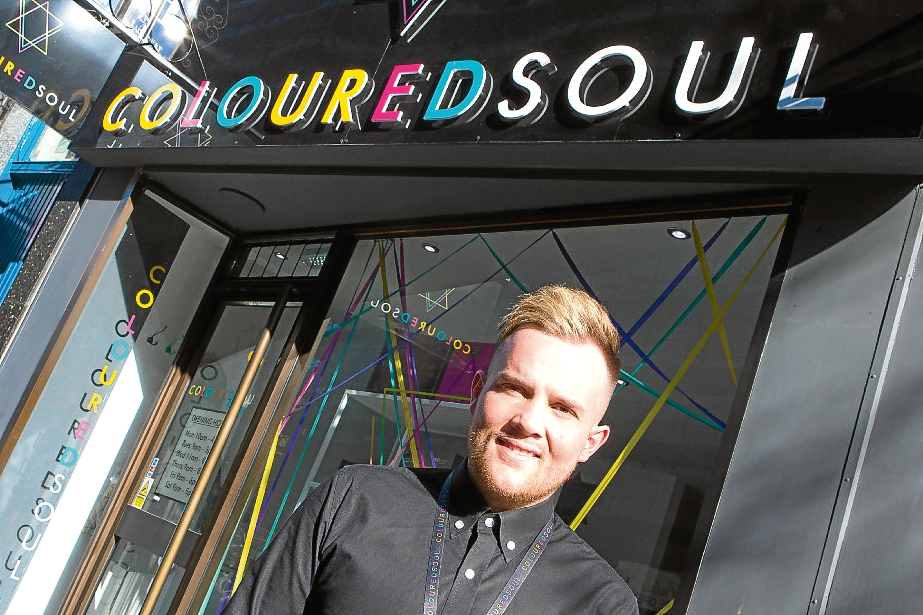 Rhys Davidson, co-owner of Coloured Soul, is celebrating after winning a national hairdressing competition.