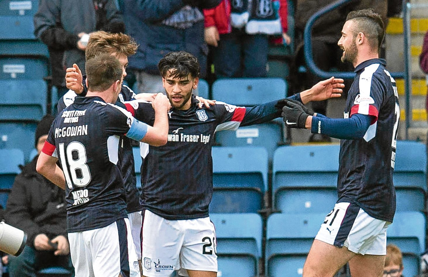 Faissal El Bakhtaoui (centre) celebrates opening the scoring during Dundee's 3-0 win at Dens against St Johnstone on Hogmanay. The Dark Blues will looking to collect at least a point next Saturday.
