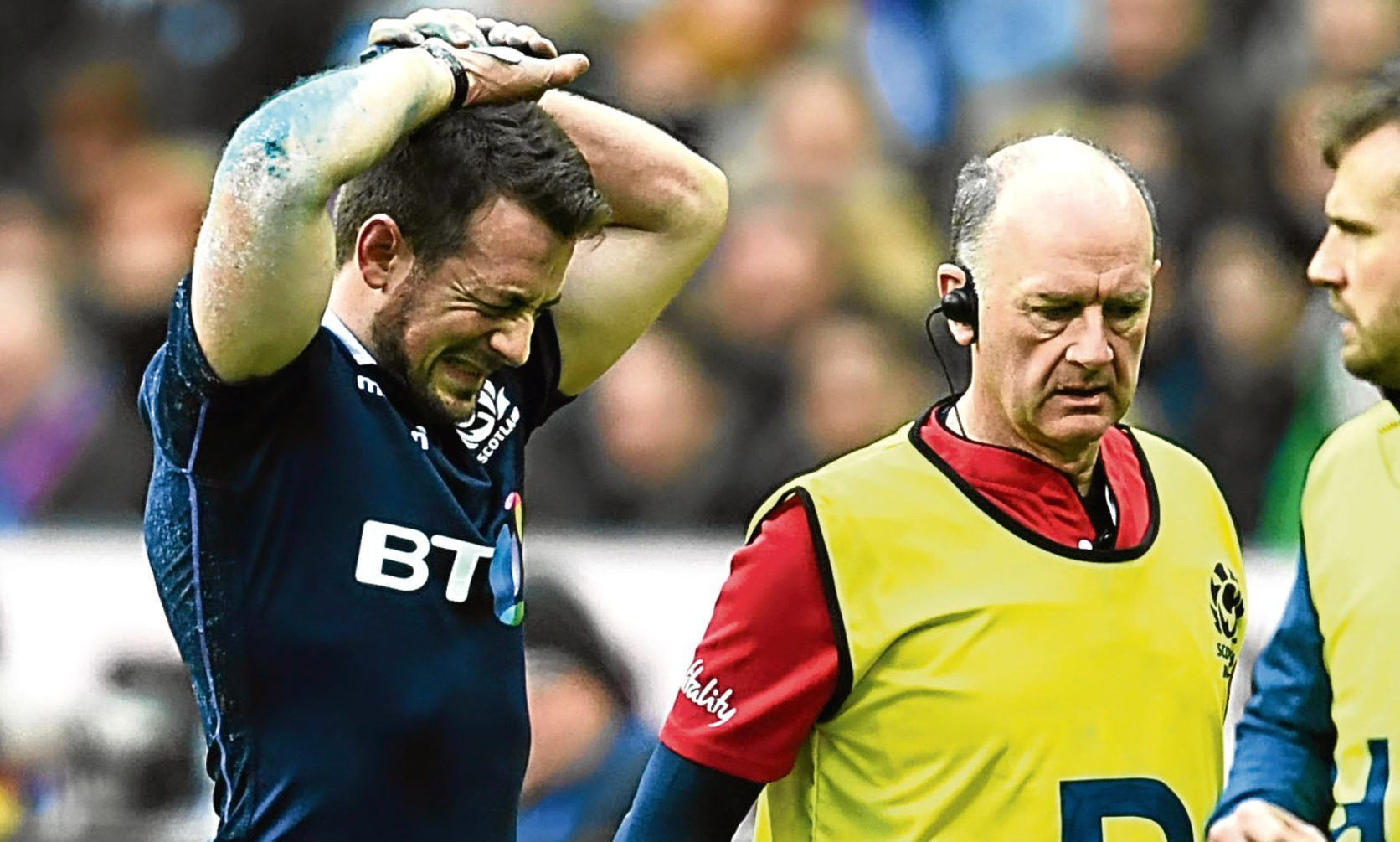 Scotland captain Greig Laidlaw comes off the park injured with team doctor James Robson (centre) during his side's RBS Six Nations game against France in Paris last month.