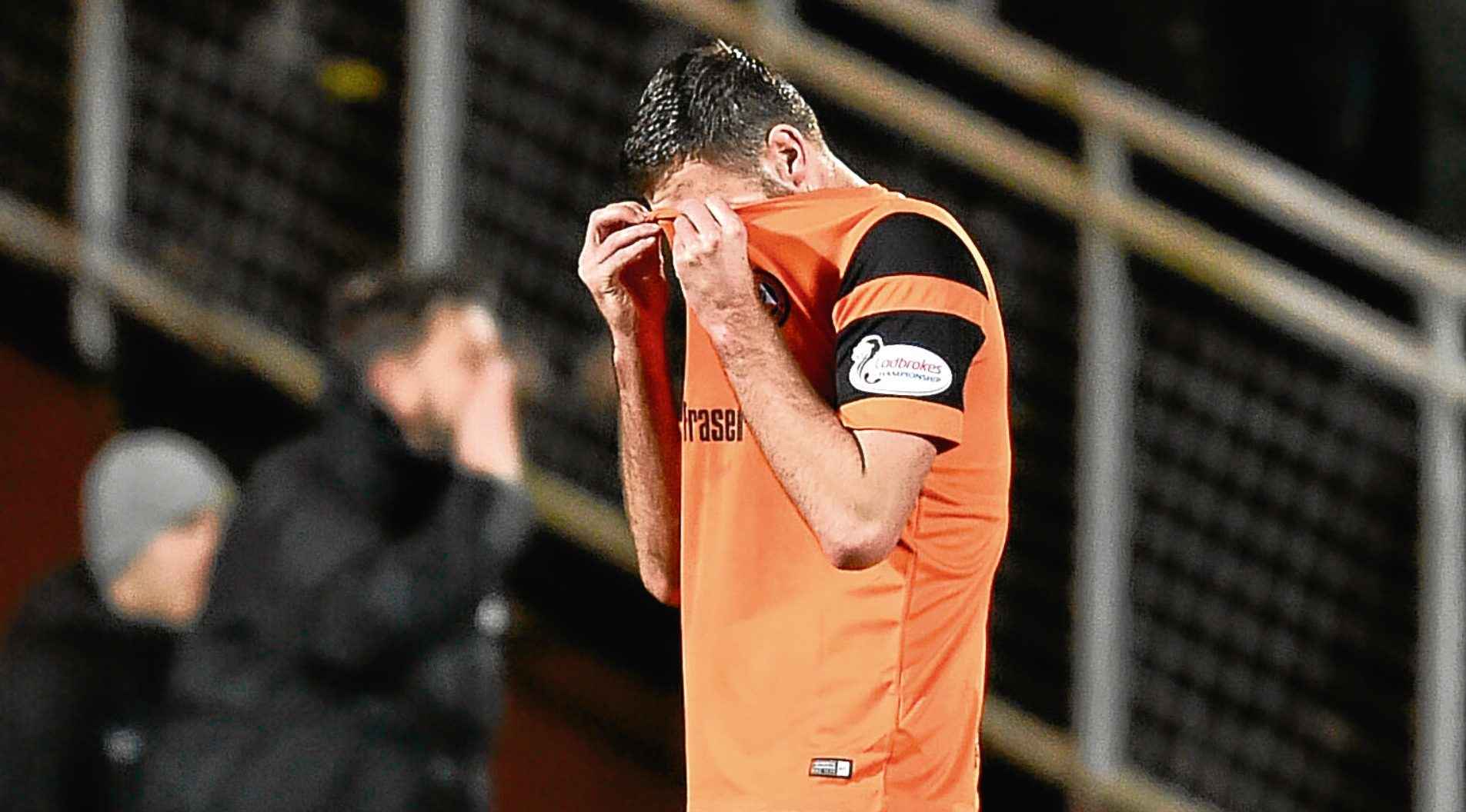 Dundee United's Lewis Toshney saw red