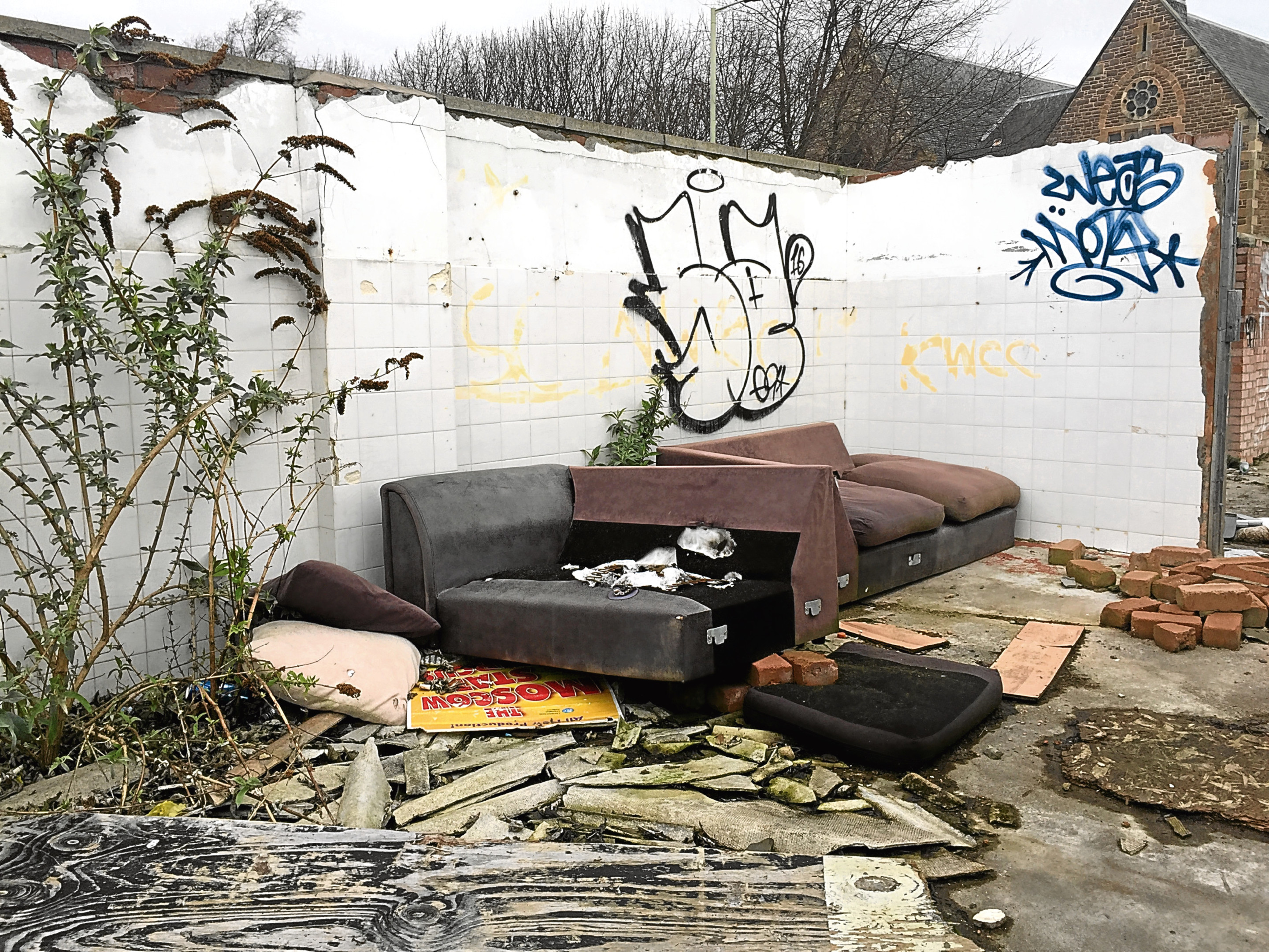 The former Maxwelltown Works site which has been plague with flytipping. Sofas have been discarded at the factory.