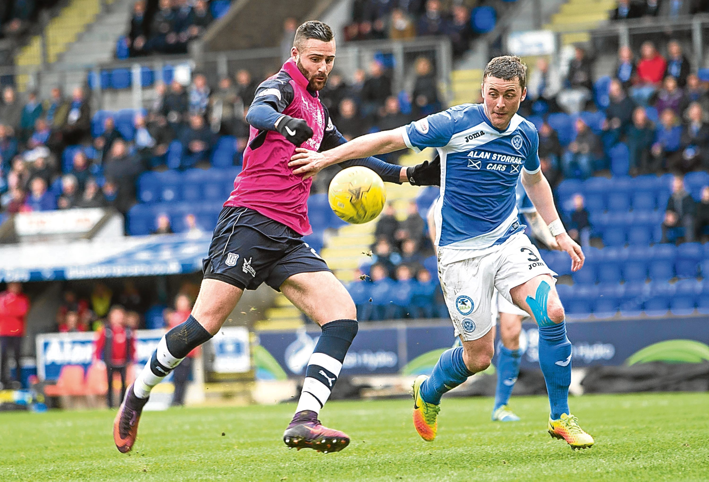 Marcus Haber's route to goal is blocked by Tom Scobbie during St Johnstone's 2-0 win at McDiarmid Park on Saturday