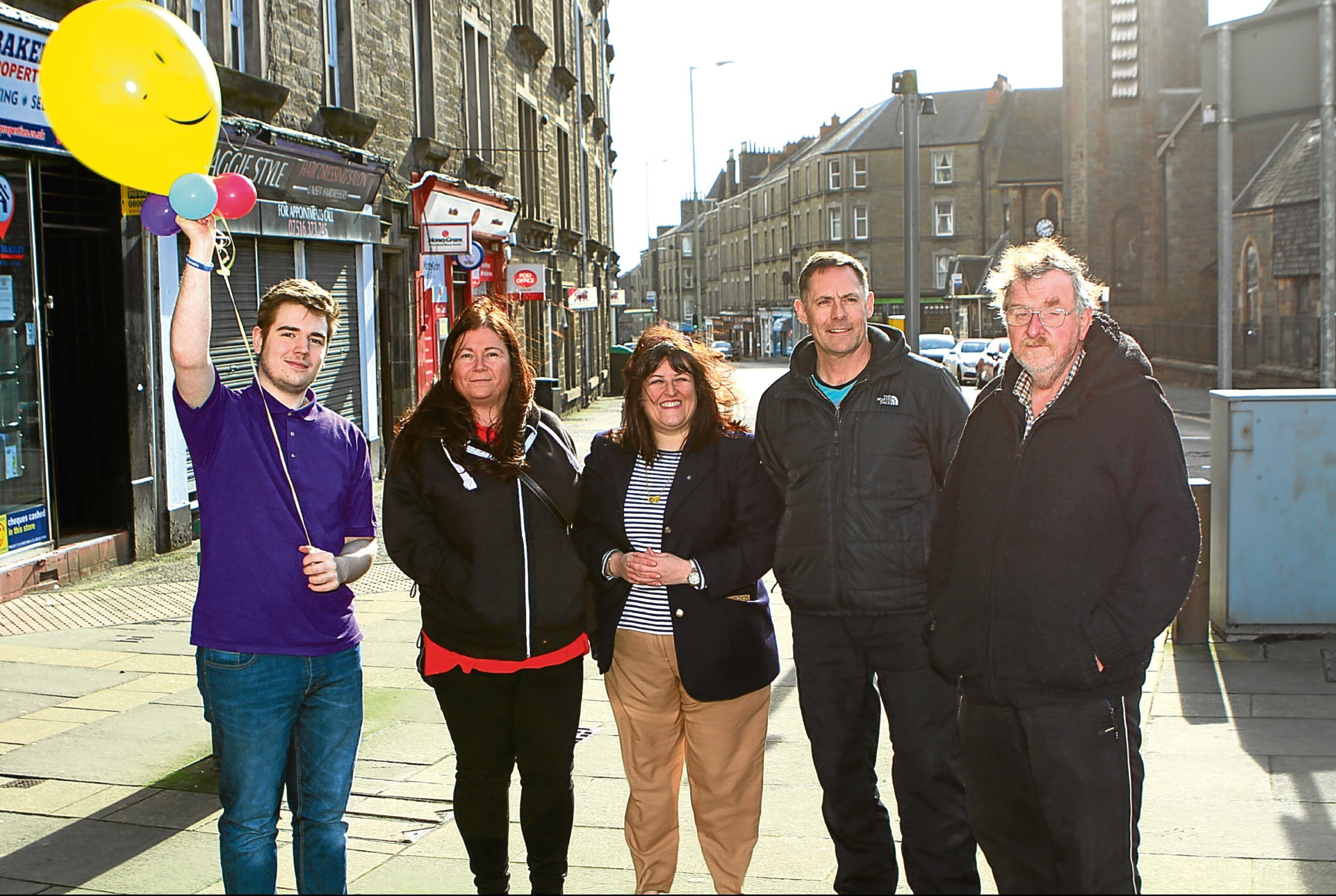 At the top of Albert Street are local traders Cameron (Balloons Made For You), Lyndsey Bertie (Bertie's Barber), Cllr Lynne Short, Colin Murray (Nicholsons Cycles) and Allan Gourlay (Brand's Books)