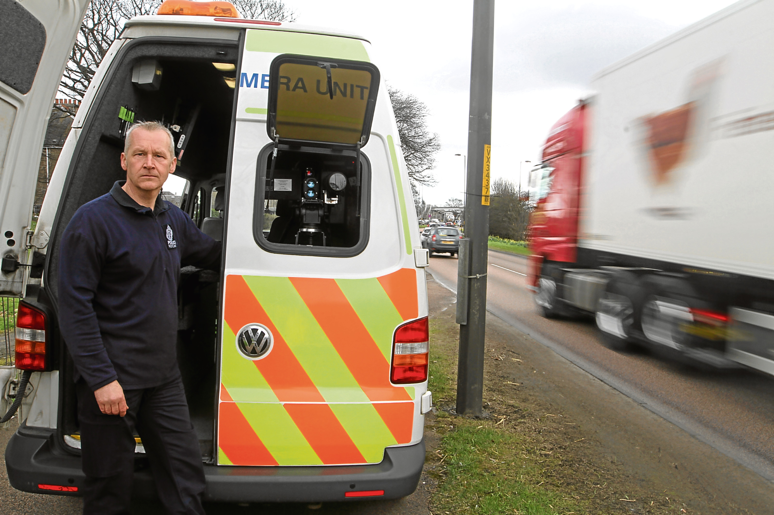 Safety camera technician Scott Aiken outside a speed van on Kingsway near the junction of Charlotte Street