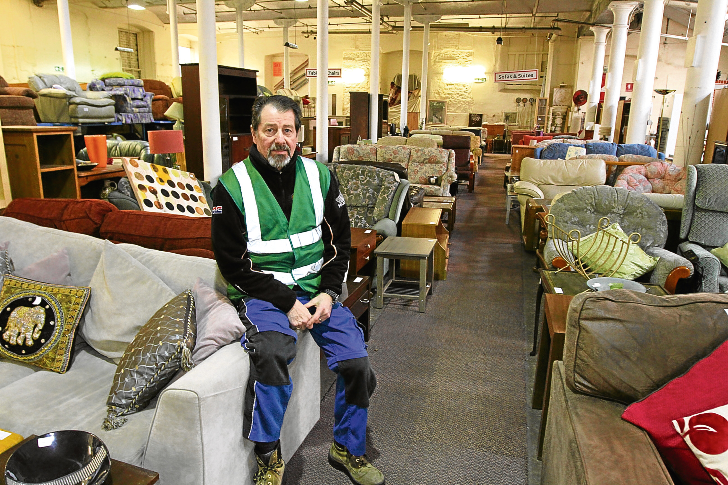 Bob Innes, of Tayside Re-Users, has helped repair several items to be sold on for Dundonians