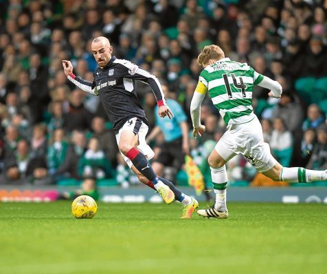 Dundee's James Vincent races away from Celtic's Stuart Armstrong in Glasgow earlier this season