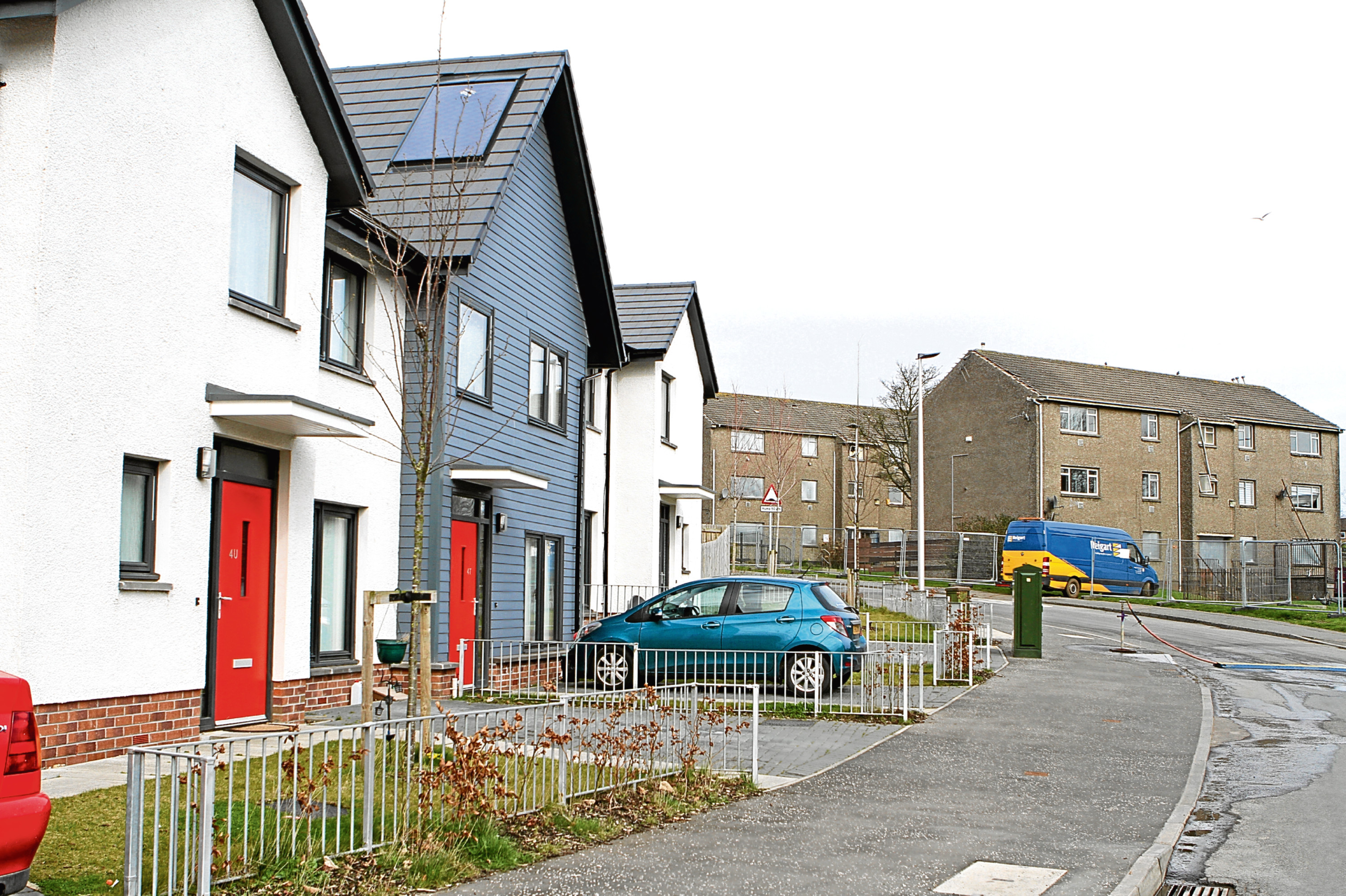 New-build houses with the flats due to be demolished in the background