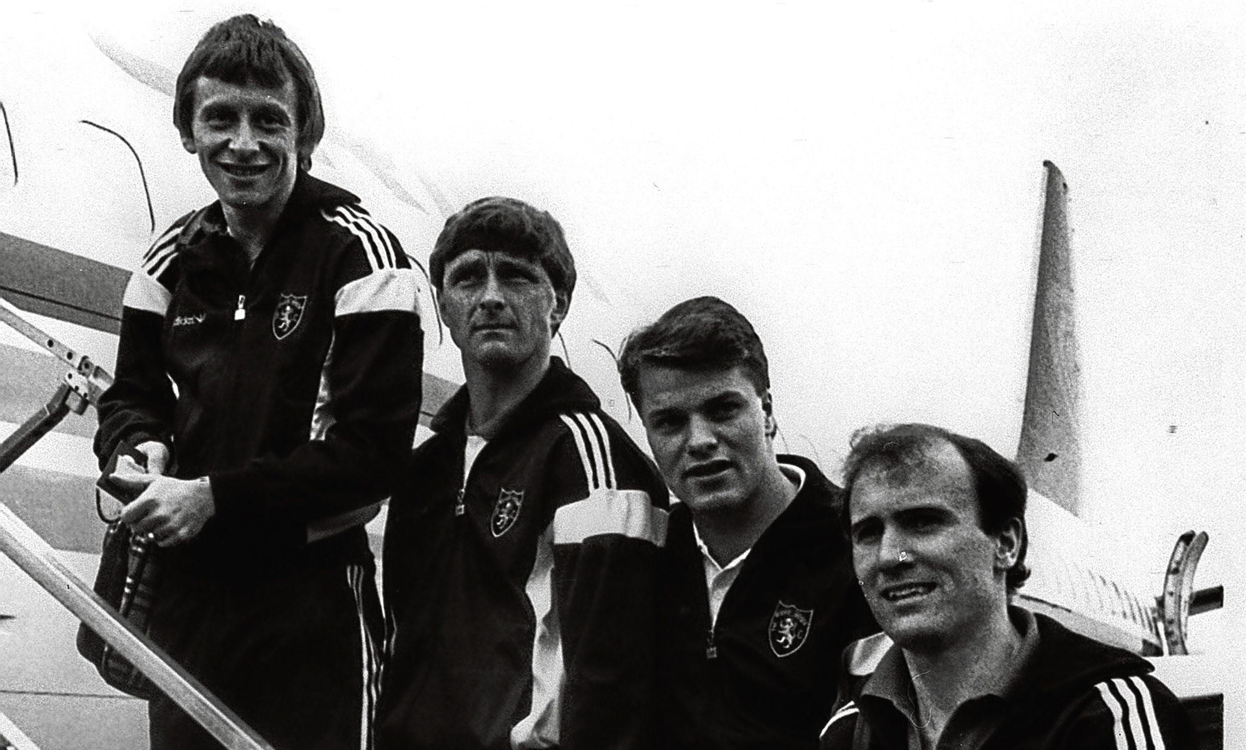 Dundee United FC players Paul Sturrock, Paul Hegarty, John Clark and Eamonn Bannon board the flight to Barcelona, 1987.