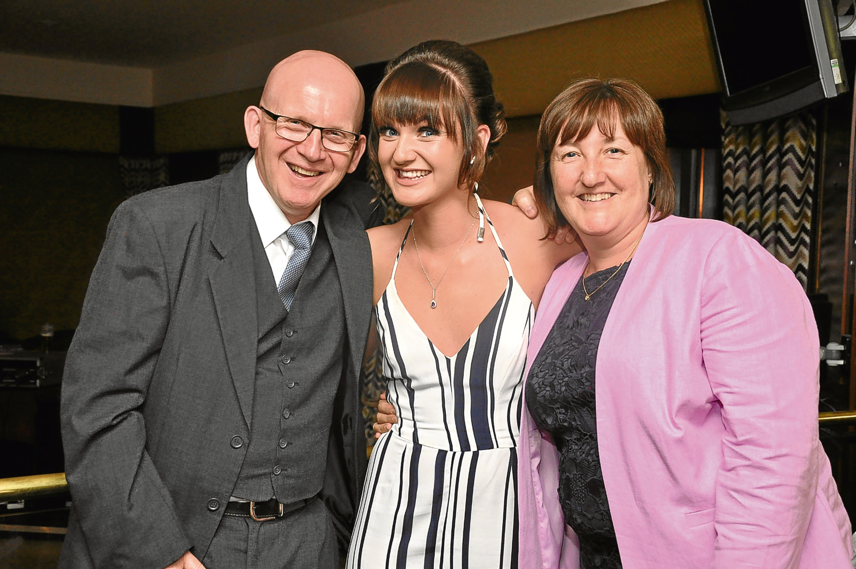 Gail Milne (right) with her husband Duncan and daughter Leanne