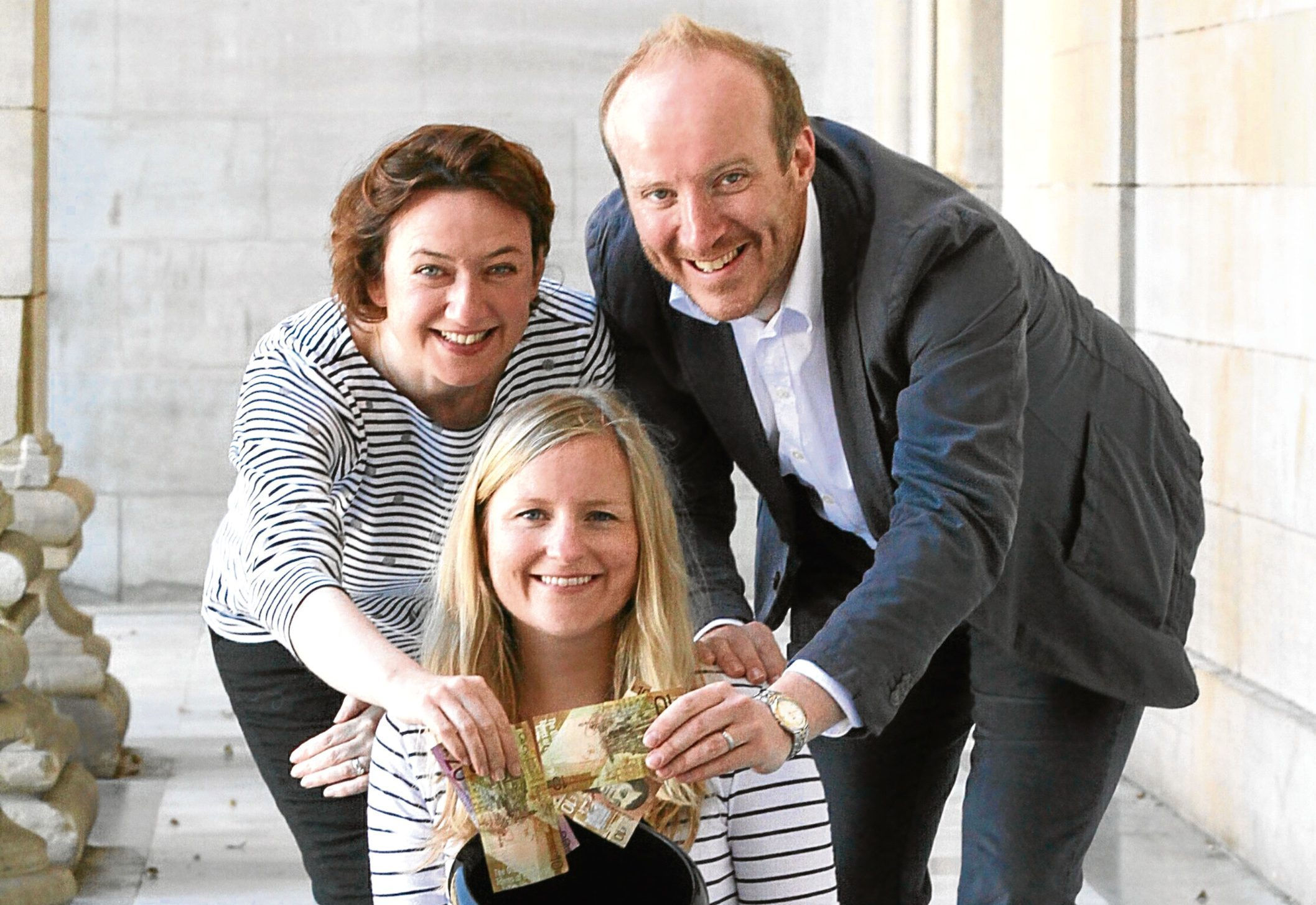 Jenny Patterson, Clairs Brennan and Michael Marra from Optimistic Sound Dundee start the ball rolling with money in a collection bucket