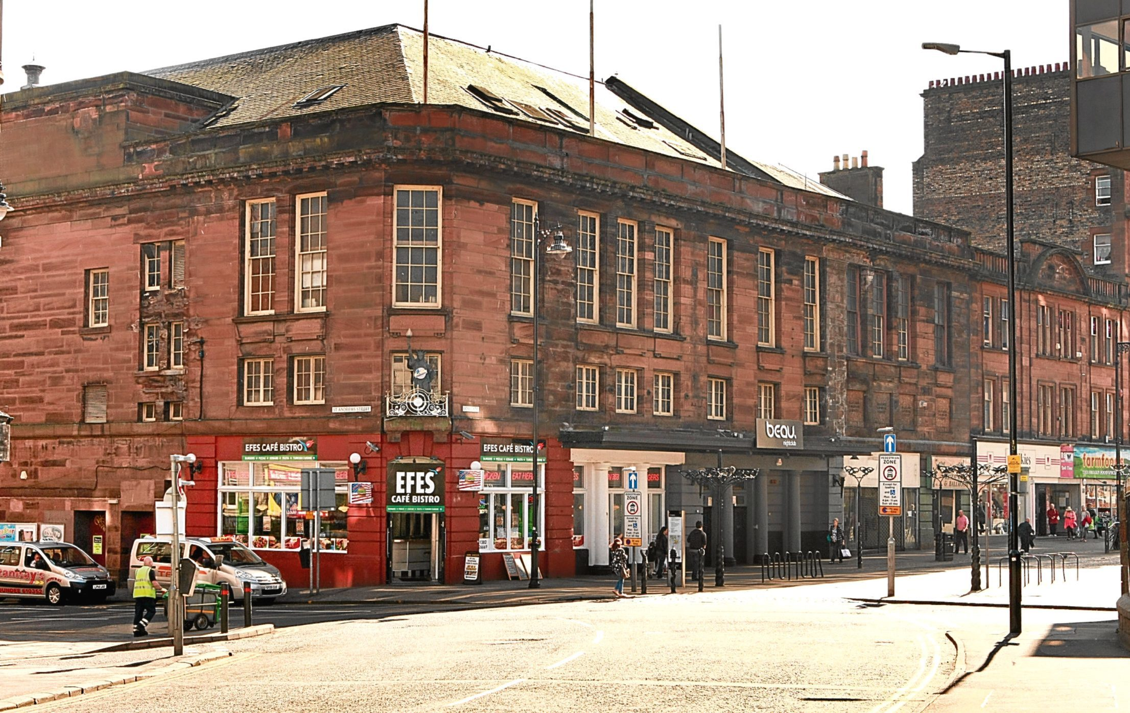 View of Cowgate and the junction with St Andrews Street, showing the former Kings Theatre