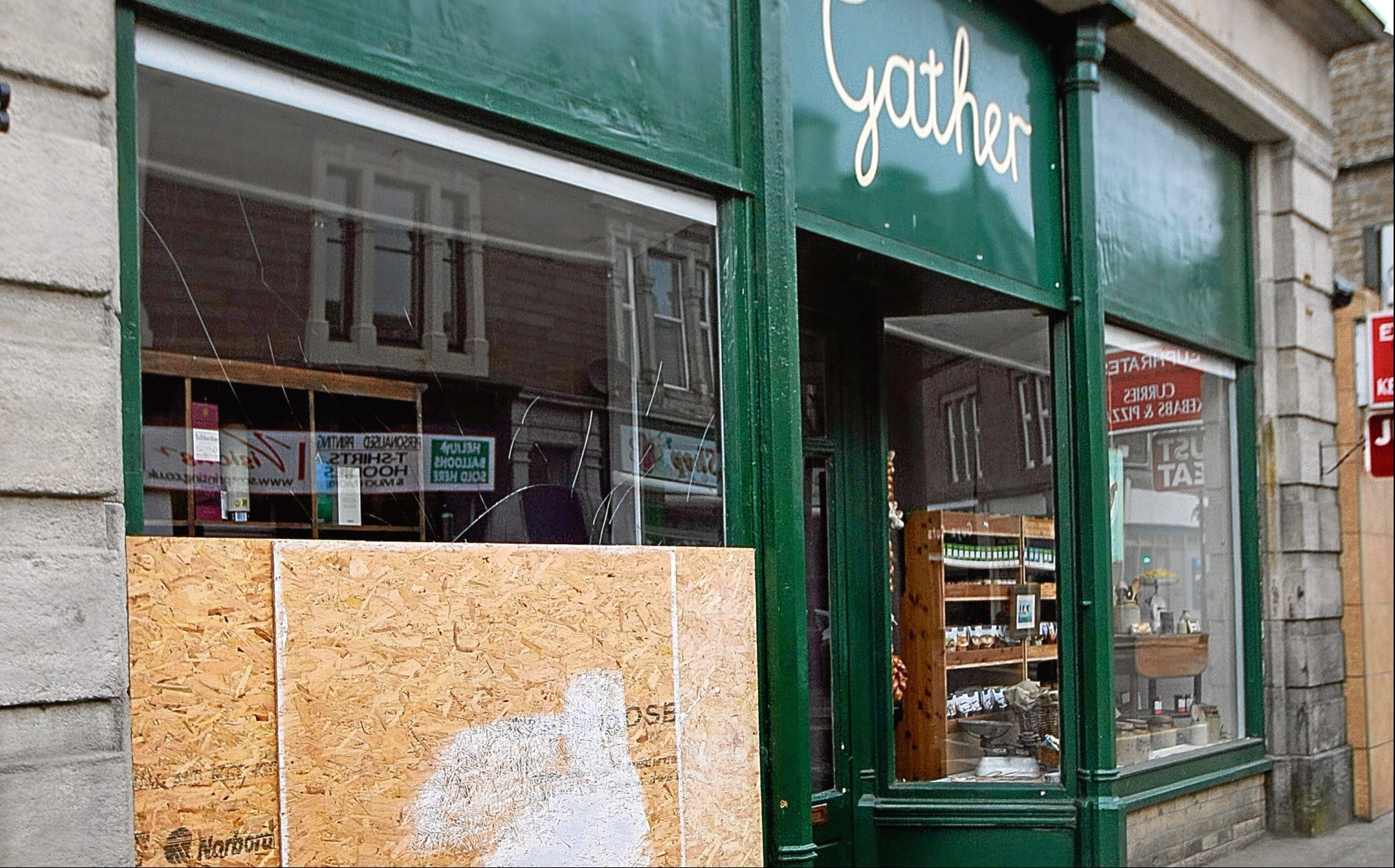 The shopfront of Gather in Carnoustie, showing a damaged window