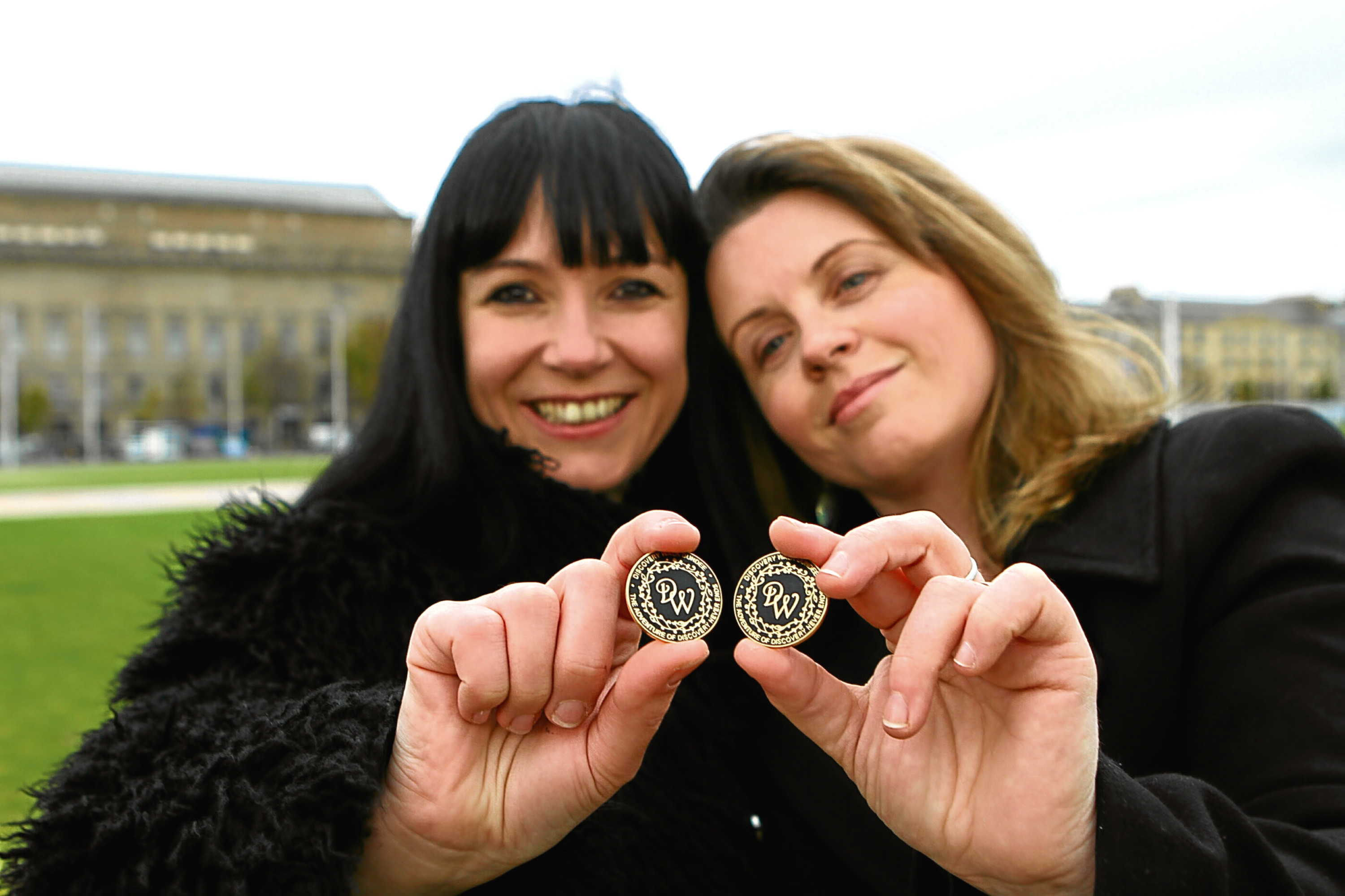 Artist Suzanne Scott, left, designer of the Discovery Walk plaques and Kelly Marr, project originator and chair of the Discovery Walk Steering Group, at Mary Slessor Gardens, with two of the badges that will be sold to crowdfund the next phase of Discovery Walk
