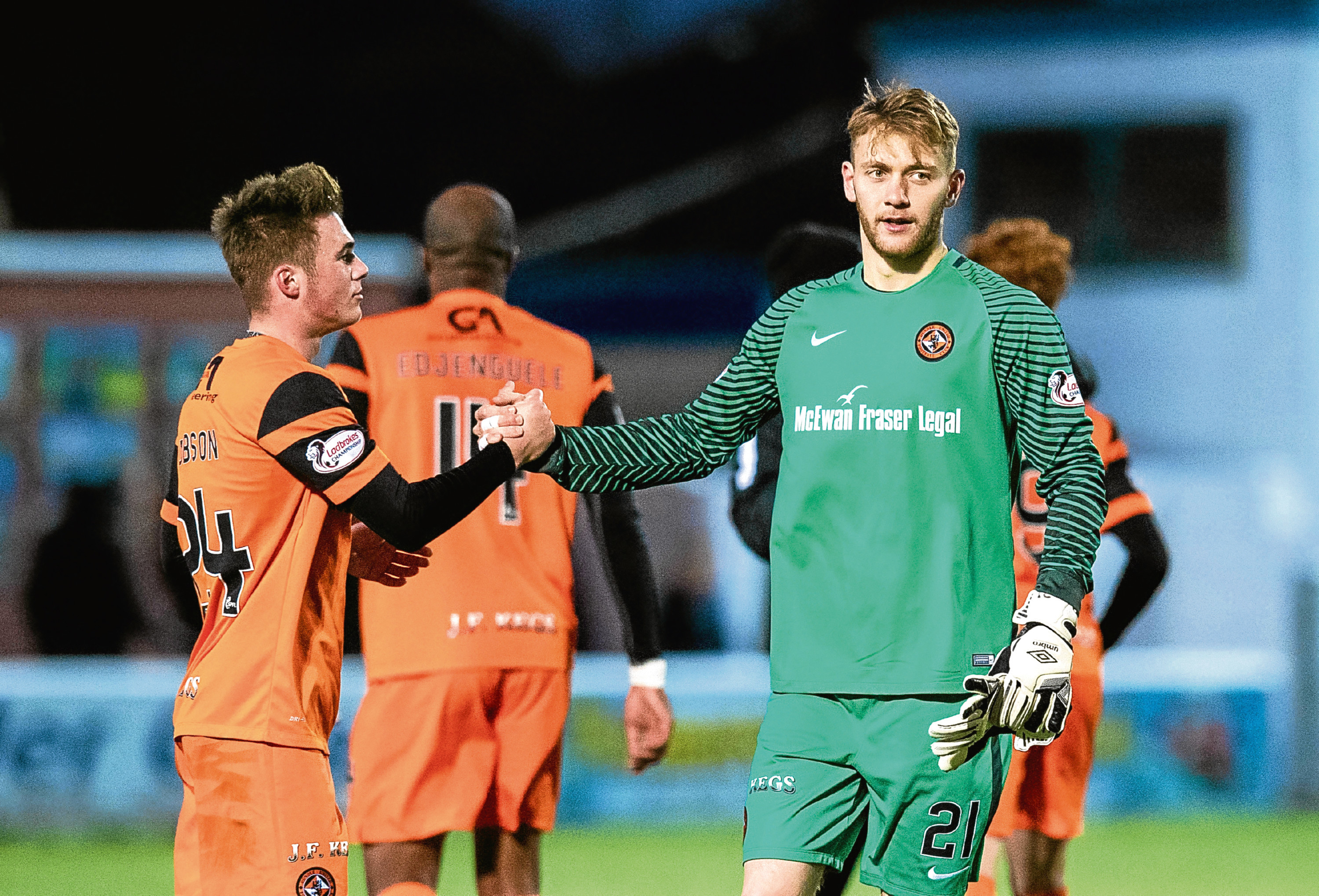 05/11/16 LADBROKES CHAMPIONSHIP   QOTS v DUNDEE UNITED (1-4)   PALMERSTON PARK - DUMFRIES   Dundee United's Jamie Robson and Luis Zwick at full time