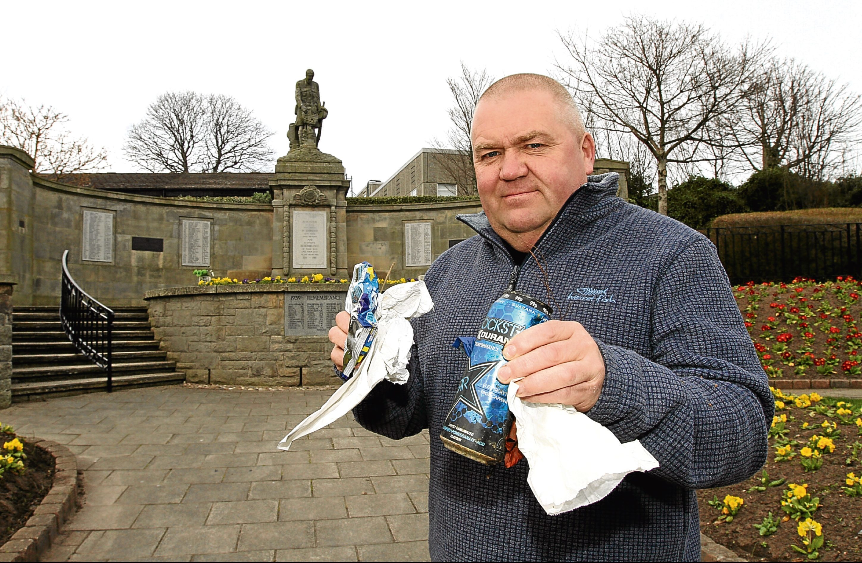 Local binman Ian Noble with rubbish picked up at the memorial