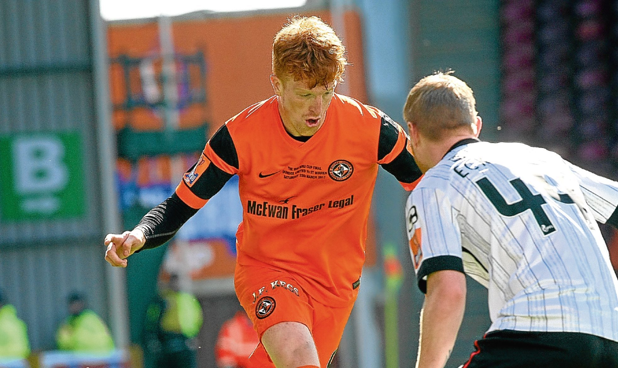 Dundee United striker Simon Murray runs at Adam Eckersley