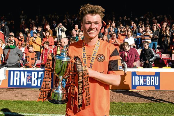 Dundee United's Jamie Robson with the Challenge Cup