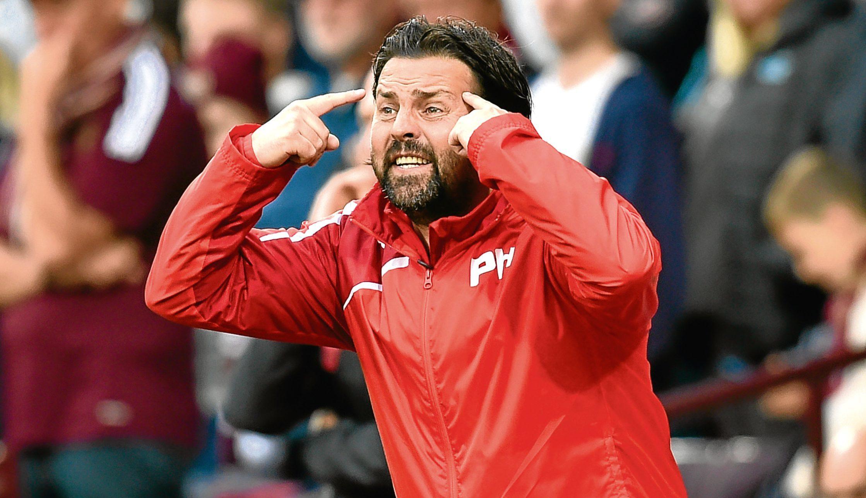 Dark blues boss Paul Hartley has problems mounting up at Dens