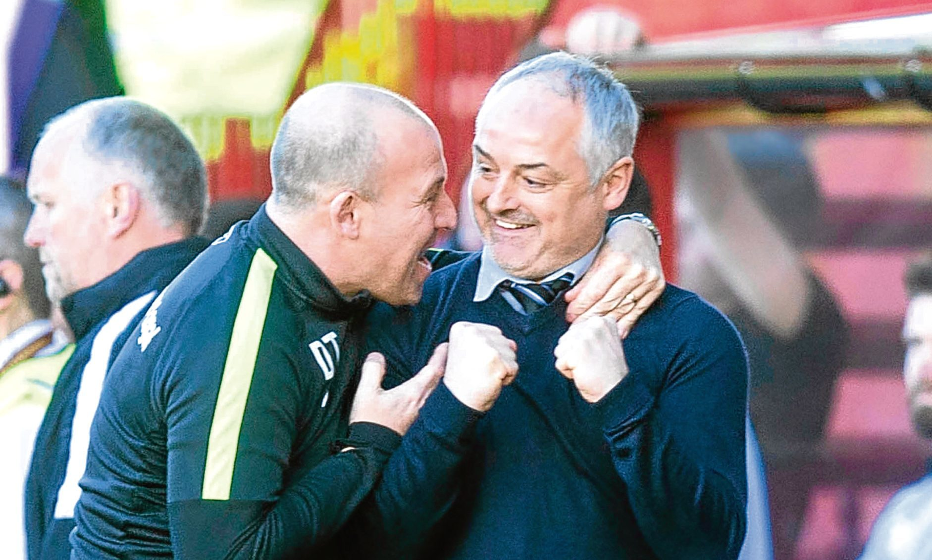 Dundee United manager Ray McKinnon and Darren Taylor celebrate victory at the full-time whistle of the Irn Bru-Cup Final at Fir Park.
