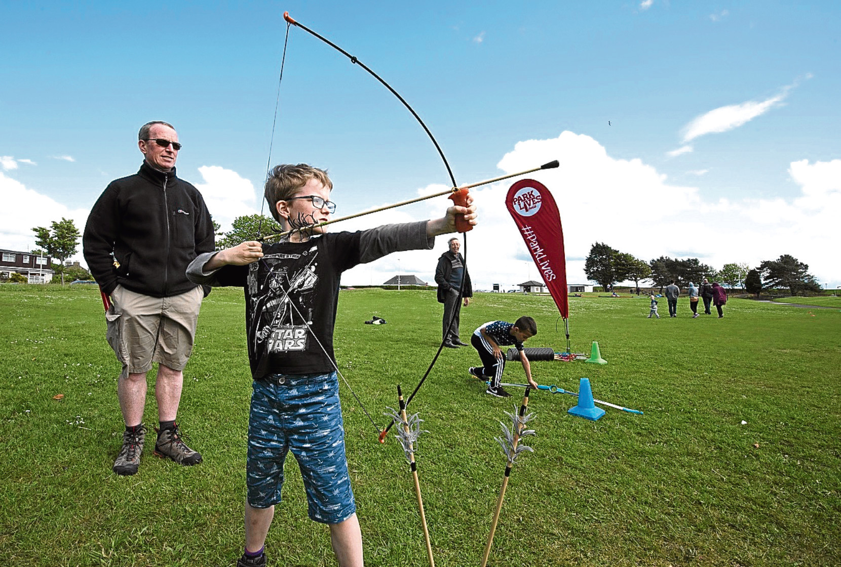 Benjamin Glancey and his dad Michael at the archery session as part of the ParkLives programme