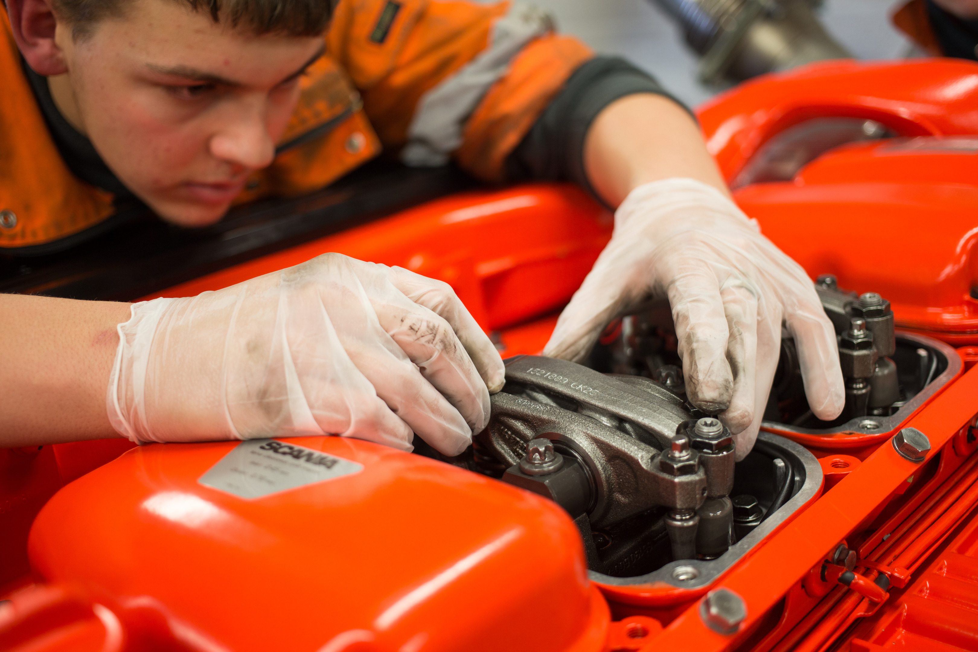 A RNLI apprentice mends an engine at the charity's workshop in Poole