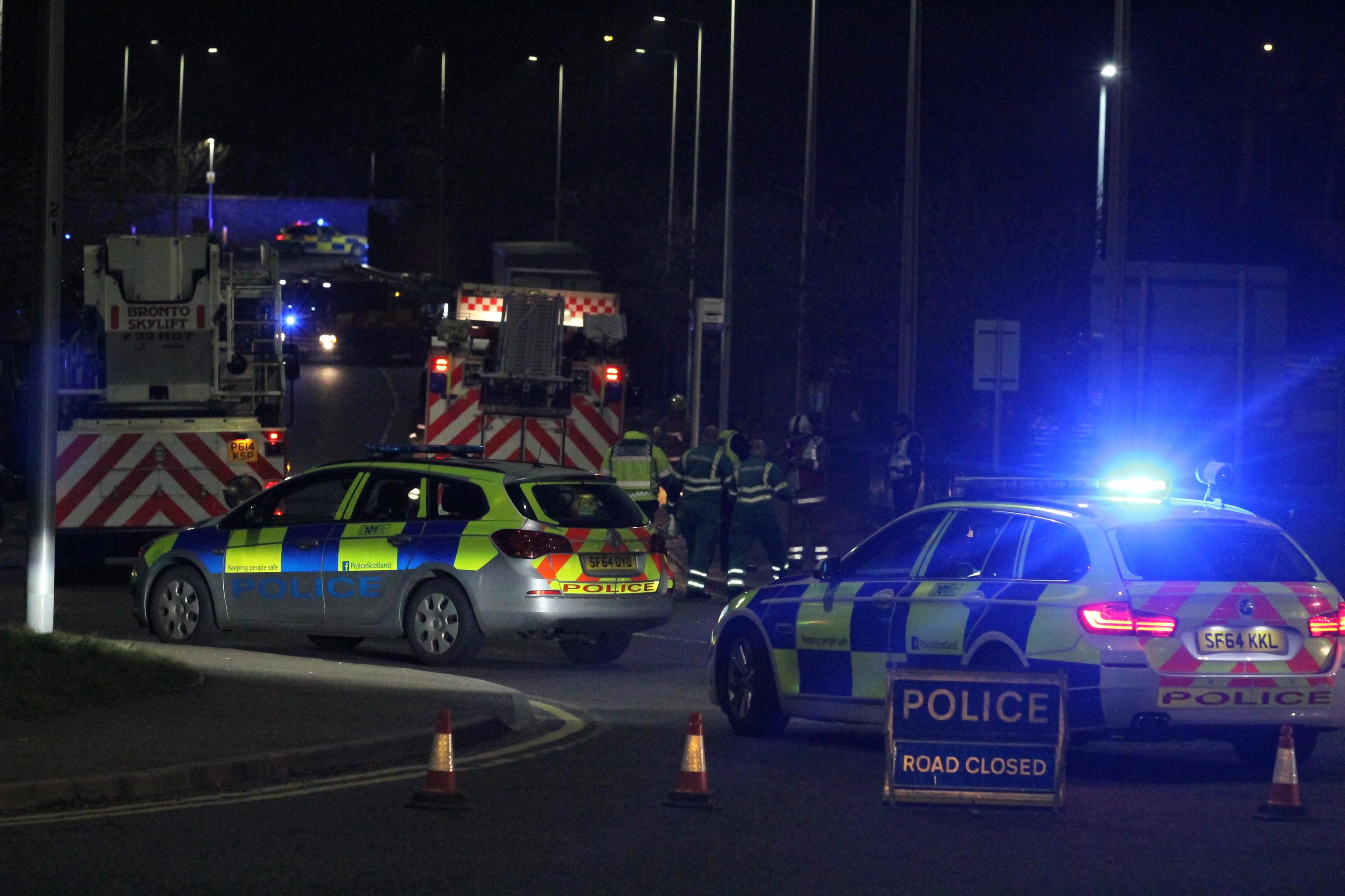 Emergency vehicles at the scene last night.